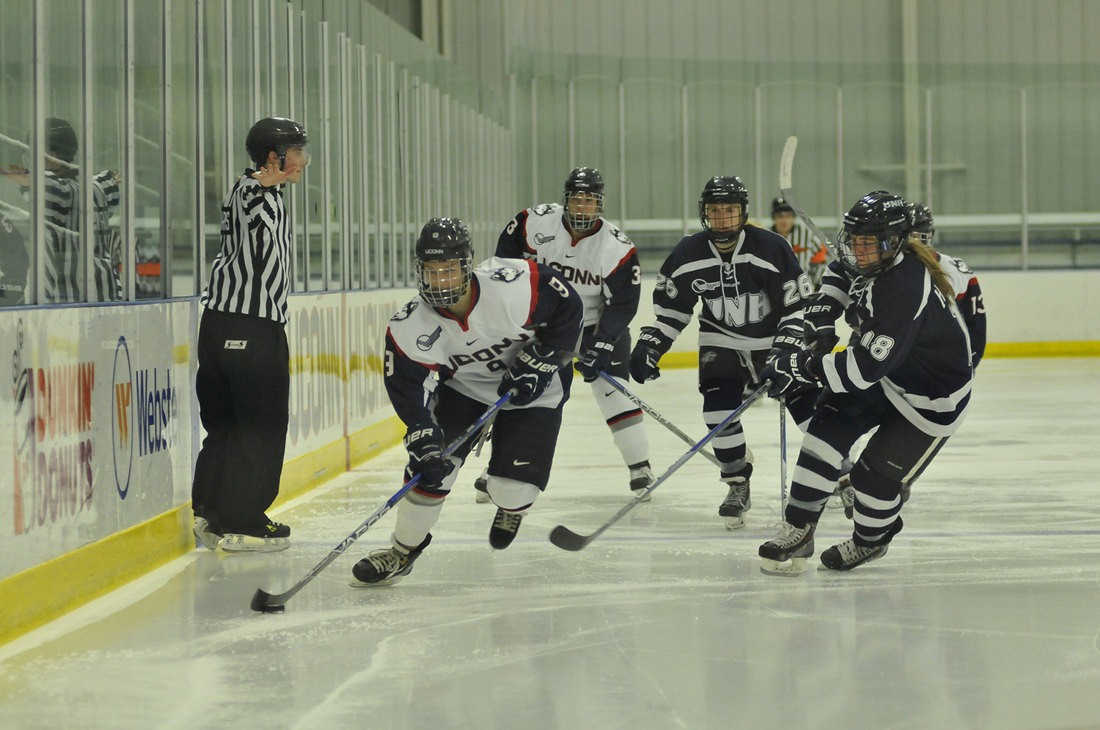 UConn junior defender Jessica Stott handles the puck during the Huskies' game against New Hampshire at the Freitas Ice Forum in Storrs, Connecticut on Sunday, Nov. 8, 2015. (Jason Jiang/The Daily Campus)
