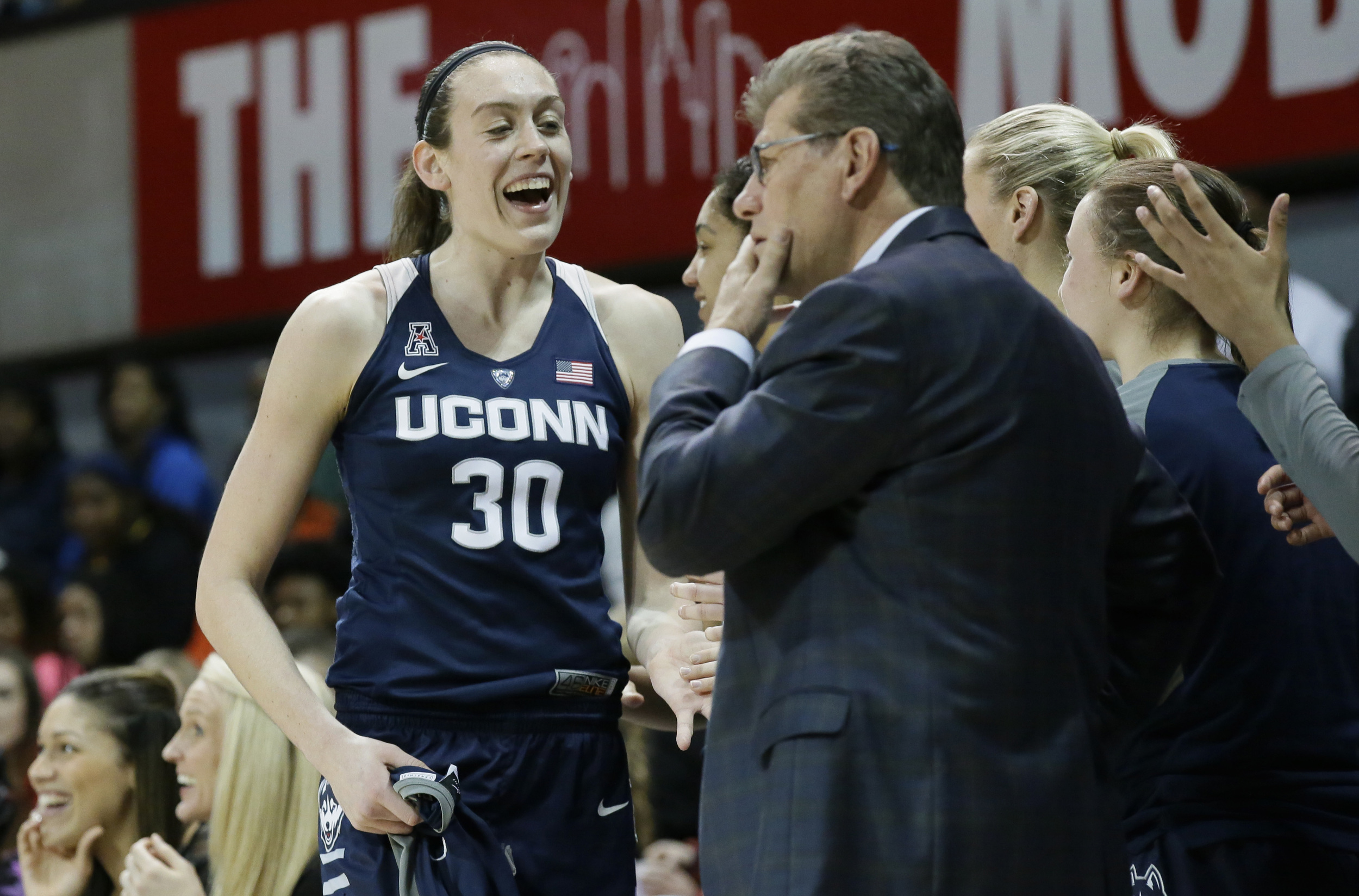 Connecticut forward Breanna Stewart (30) is congratulated by teammates as she comes out of the game during the second half of an NCAA college basketball game against SMU Saturday, Jan. 23, 2016, in Dallas. UConn won 90-37. (LM Otero/AP)