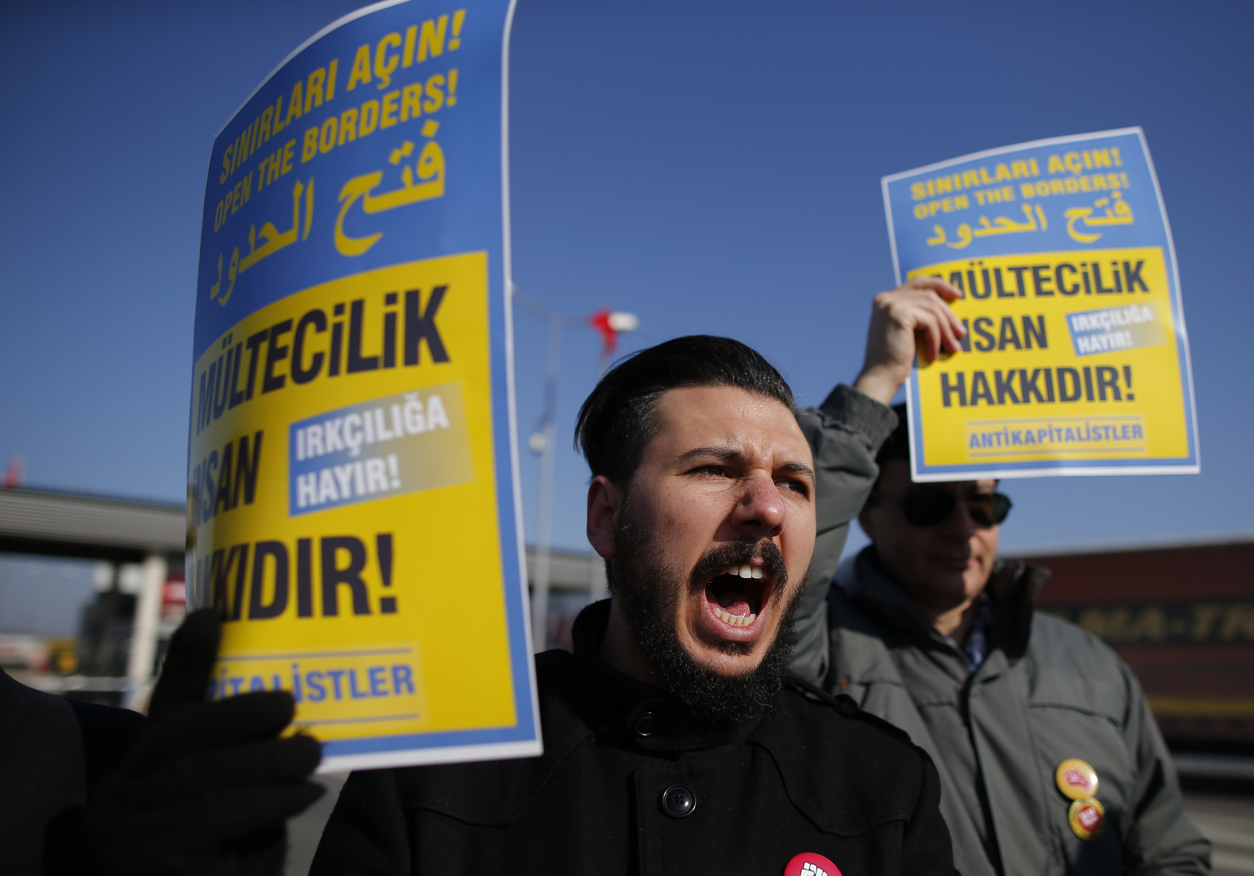 A group of Turkish protesters chant slogans as they hold a demonstration along with Greek protesters in front of Ipsala border gate with Greece, in Turkey's northwestern province of Edirne, Sunday, Jan. 24, 2016.(Emrah Gurel/AP)