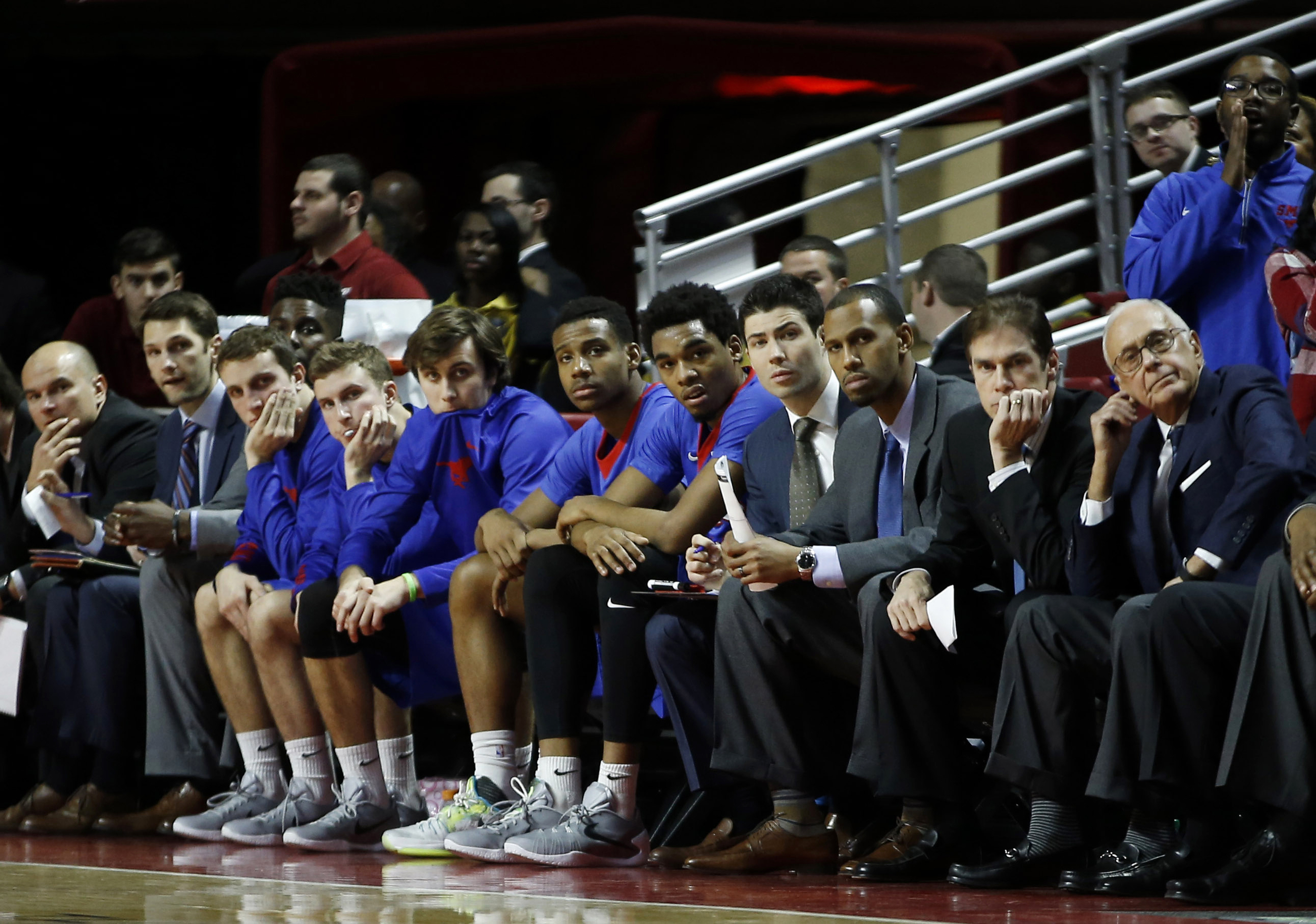 SMU players and coaches watch from the bench during the final minutes of an NCAA college basketball game against Temple, Sunday, Jan. 24, 2016, in Philadelphia. Temple won 89-80. (Matt Slocum/AP)