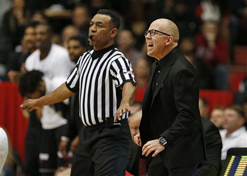 Cincinnati head coach Mick Cronin, right, shouts instructions to his team during the first half of an NCAA college basketball game against Memphis, Thursday, Jan. 21, 2016, in  Cincinnati . (AP Photo/Gary Landers)