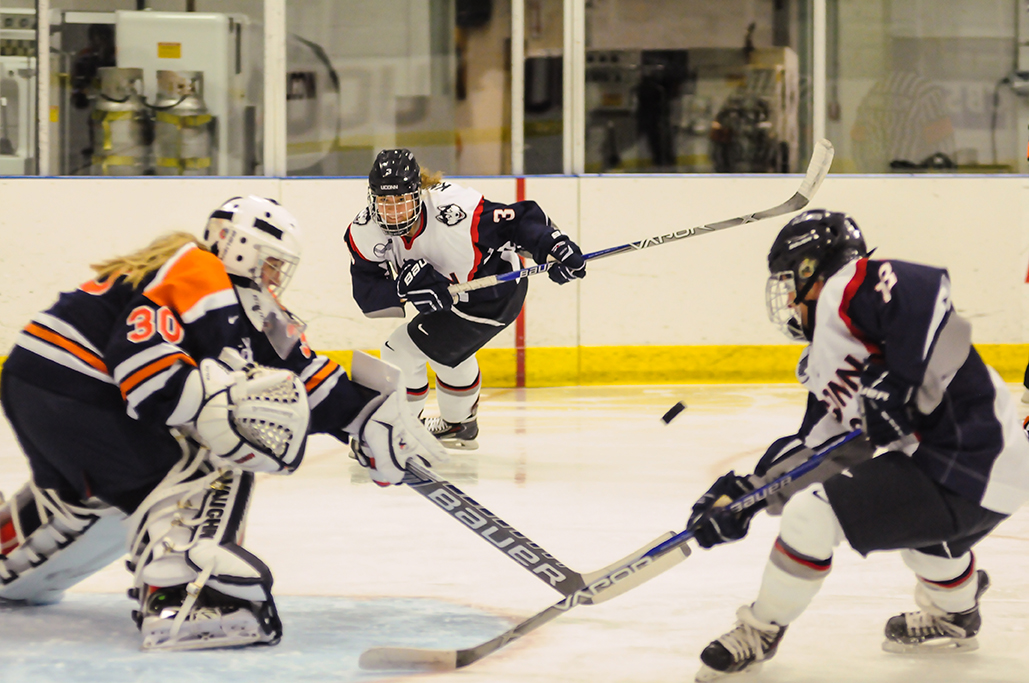 UConn women's ice hockey sophomore forward Theresa Knutson (middle) skates toward the net during the Huskies' game against Syracuse at the Freitas Ice Forum in Storrs, Connecticut on Saturday, Oct. 17, 2015. (Jason Jiang/The Daily Campus)