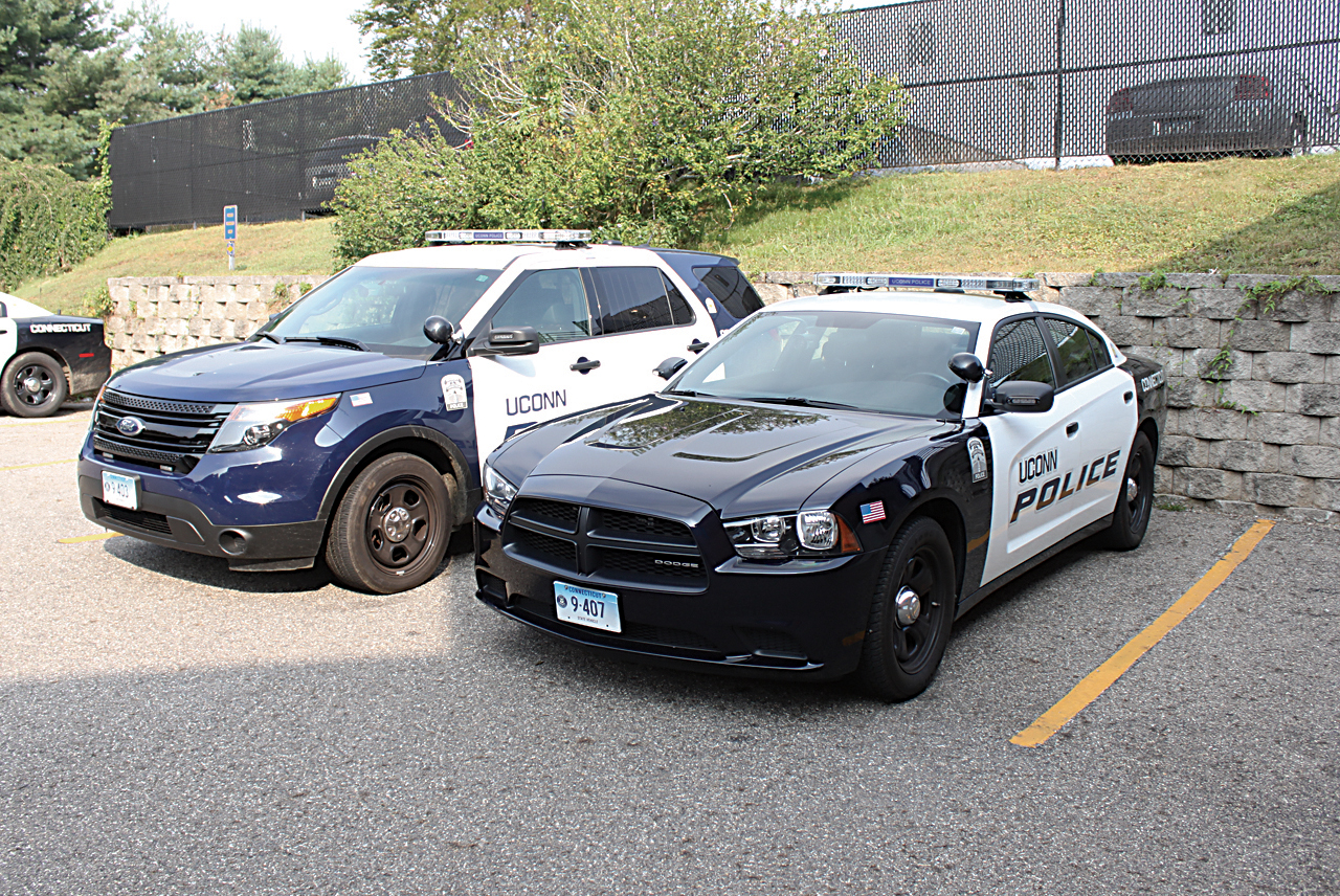 The above file photo shows two UConn police cars. Six UConn police officers on the Storrs campus are now wearing body cameras as part of a pilot program that will eventually extend to the whole police force by the summer. (File Photo/Daily Campus)