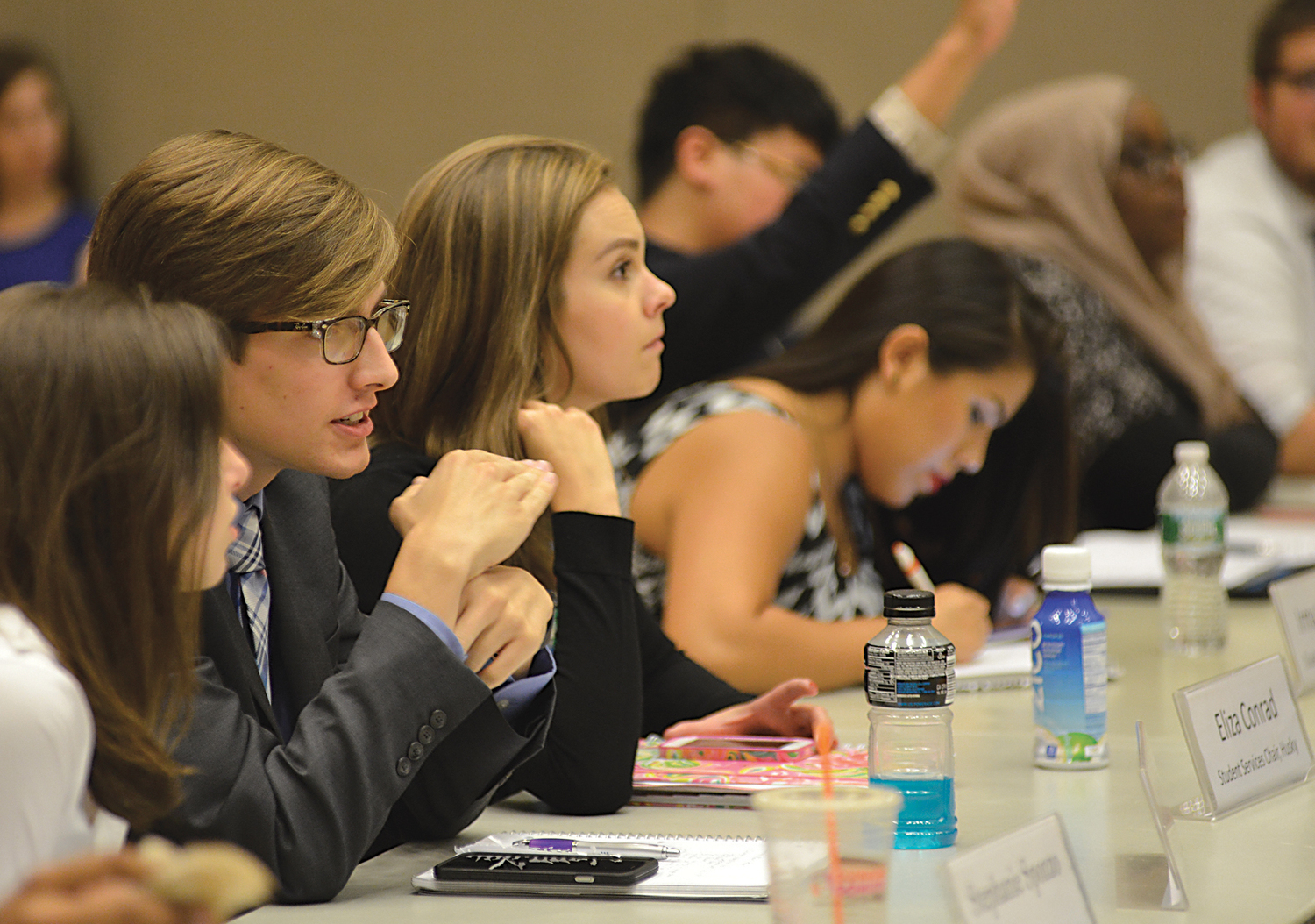 USG senator Daniel Byrd (middle) speaks with fellow senators during the Undergraduate Student Government's meeting in the Student Union on Wednesday, Sept. 16, 2015. (Jason Jiang/The Daily Campus)