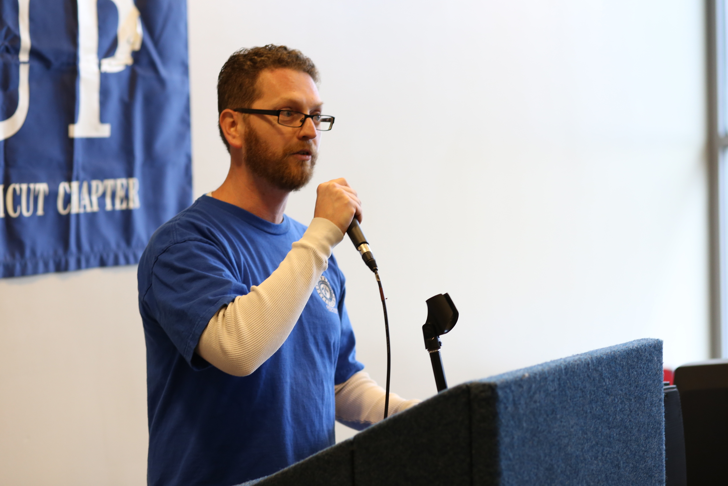 Todd Vachon, president of the UConn Graduate Student Employment Union, speaks at the AAUP rally on Feb. 24 in the Student Union (Jackson Haigis/The Daily Campus)