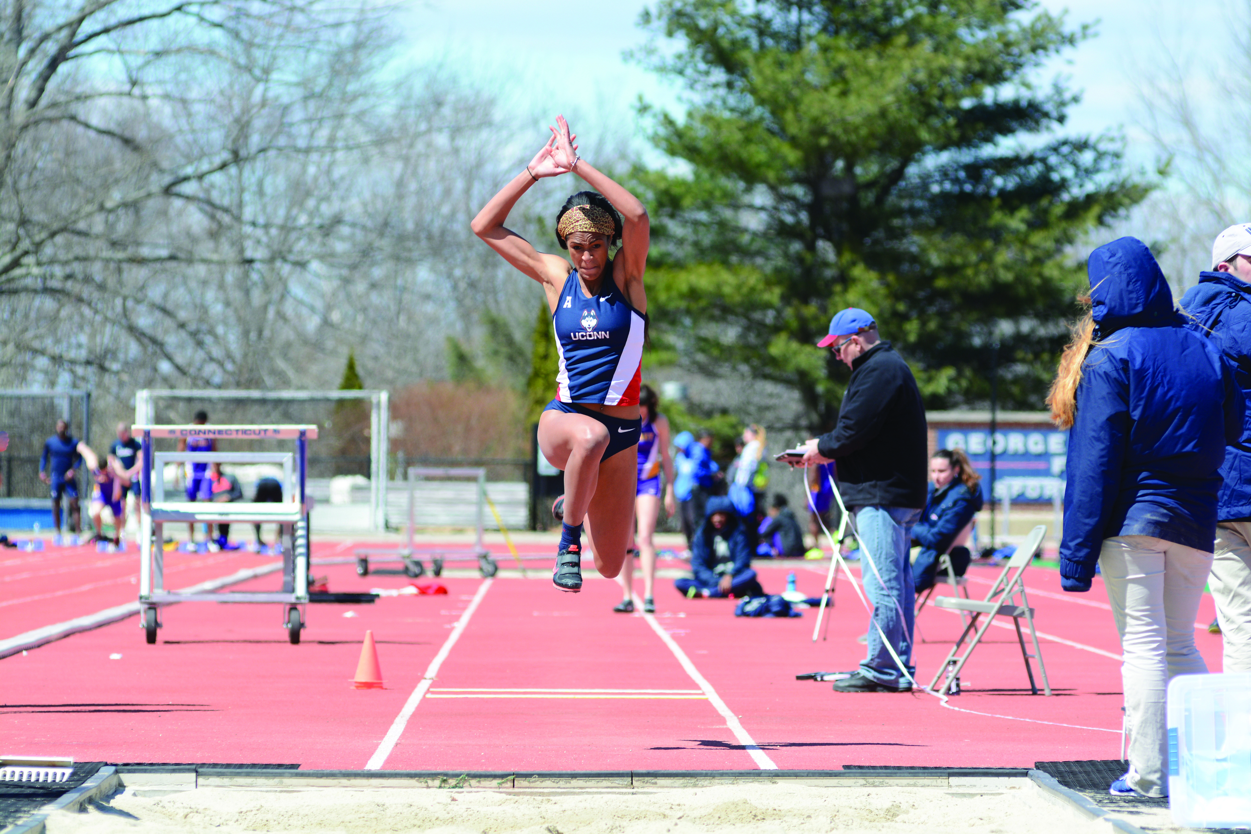 Sarah Bowens competes in the long jump at a meet on April 11, 2015 at the George J. Sherman Family Sports Complex in Storrs. Bowens finished eighth in the triple jump and third in the long jump at the American Athletic Conference championship meet this past weekend. (Photo by Jason Jiang/The Daily Campus)