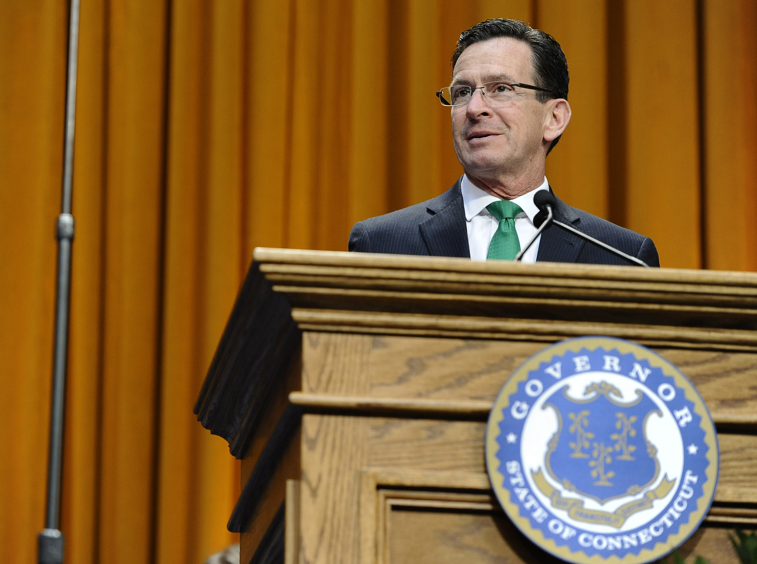 Connecticut Gov. Dannel P. Malloy speaks after being sworn in for his second term, Wednesday, Jan. 7, 2015, inside the William A. O'Neill Armory in Hartford Conn. (Jessica Hill, Pool/AP)