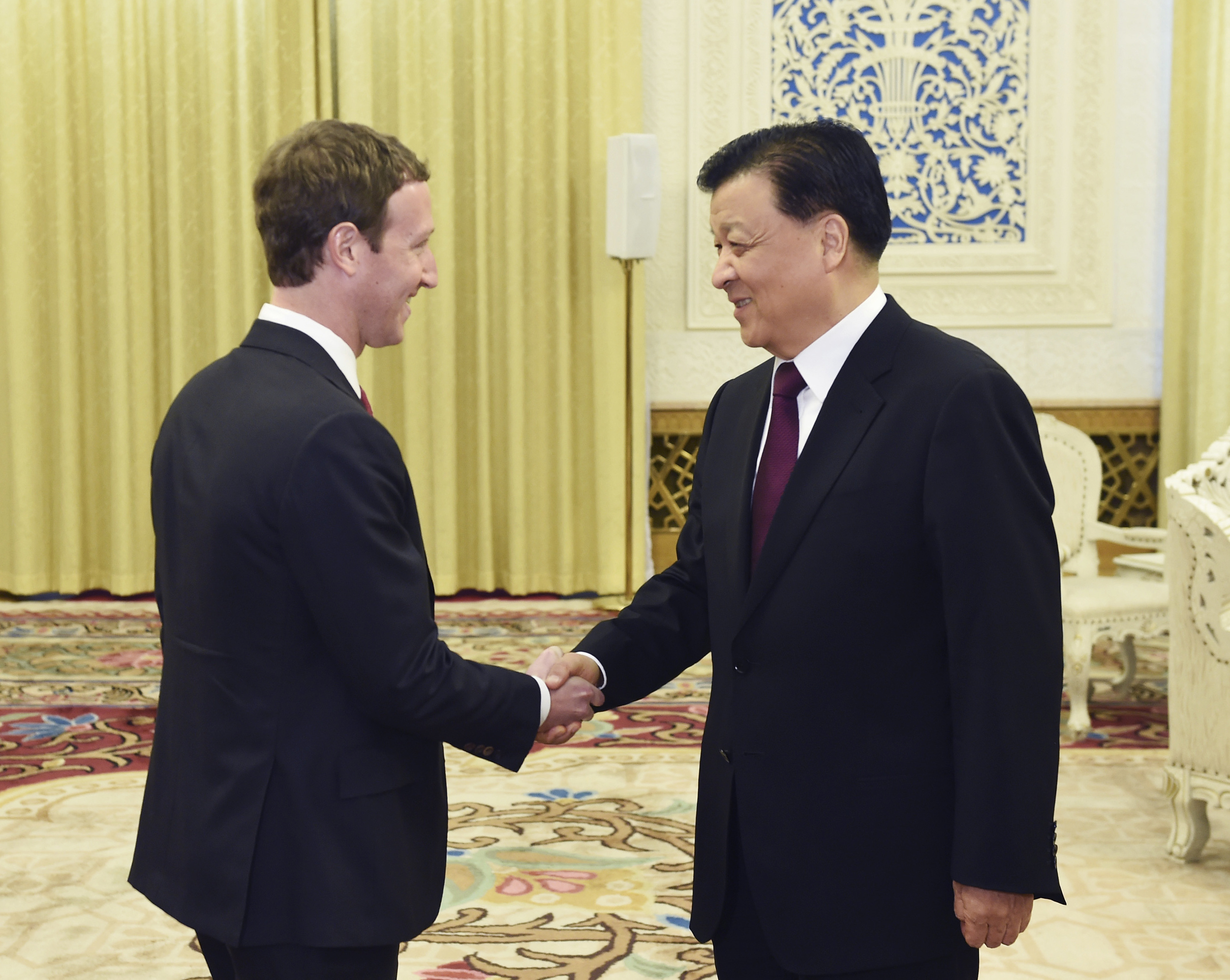 In this March 19, 2016 photo provided by China's Xinhua News Agency, Liu Yunshan, right, a member of the Politburo Standing Committee meets with Facebook founder and CEO Mark Zuckerberg in Beijing, the capital of China.Facebook founder Zuckerberg held a rare meeting with China's propaganda chief Liu at a time when Chinese authorities are tightening control over their cyberspace. (Wang Ye/Xinhua News Agency via AP)