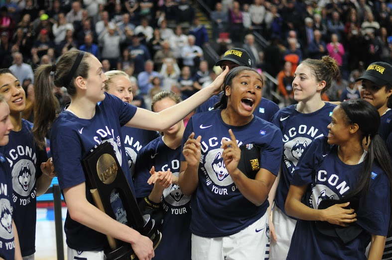 From left to right: Breanna Stewart, Morgan Tuck and Moriah Jefferson goof around following their 86-65 victory over No. 2 seed Texas in the Elite Eight on Monday, March 28 at Webster Bank Arena in Bridgeport, Connecticut. Tuck scored a team high 22 points, while Stewart had 21 and Jefferson had 11. It is the trio's last NCAA tournament in a Huskies uniform. (Bailey Wright/The Daily Campus)