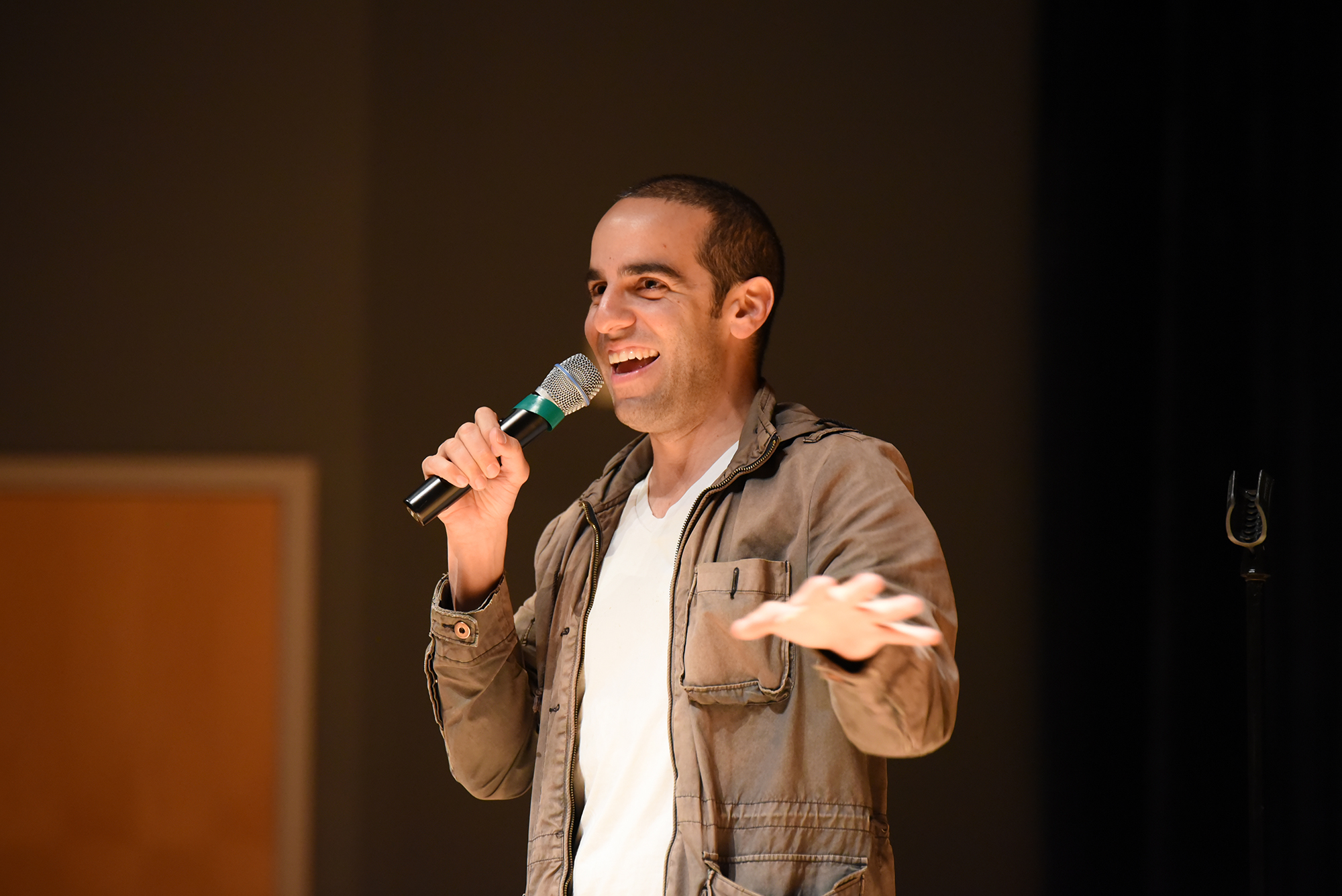 Comedian Dan Ahdoot during his show in the Student Union Theater in Storrs, Connecticut on Thursday, April 7, 2016. (Zhelun Lang/The Daily Campus)