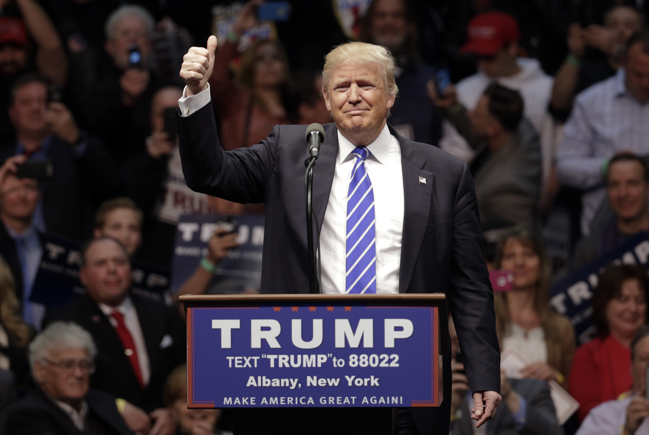 Republican presidential candidate Donald Trump acknowledges the crown during a rally at the Times Union Center on Monday, April 11, 2016, in Albany, N.Y. (AP Photo/Mike Groll)