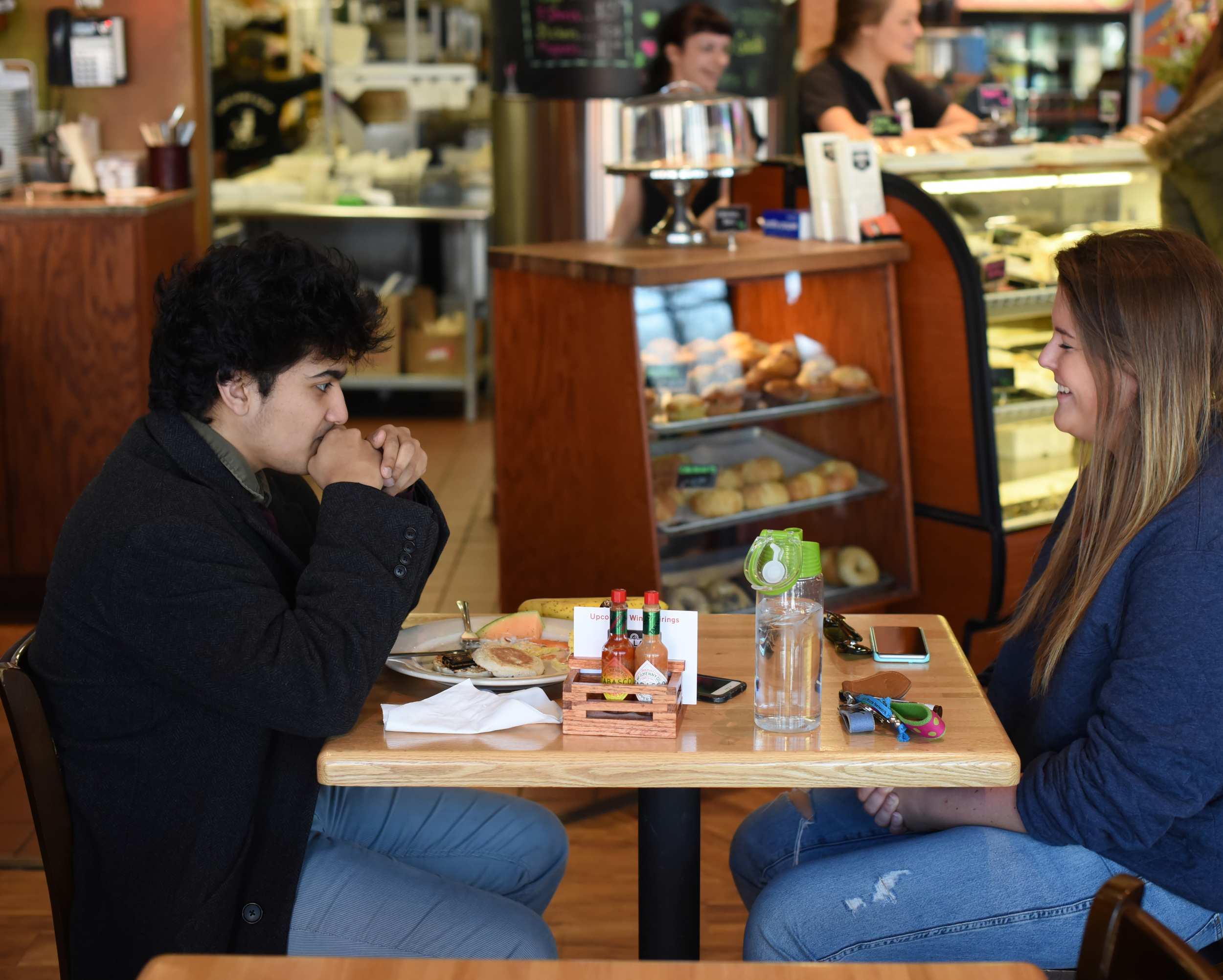 Dani Kosinski, a long-time sports fan, pictured with Associate Life Editor Anokh Palakurthi,jokes her ideal date would include a trip to a Giants or Yankees game. (Zhelun Lang/Daily Campus)