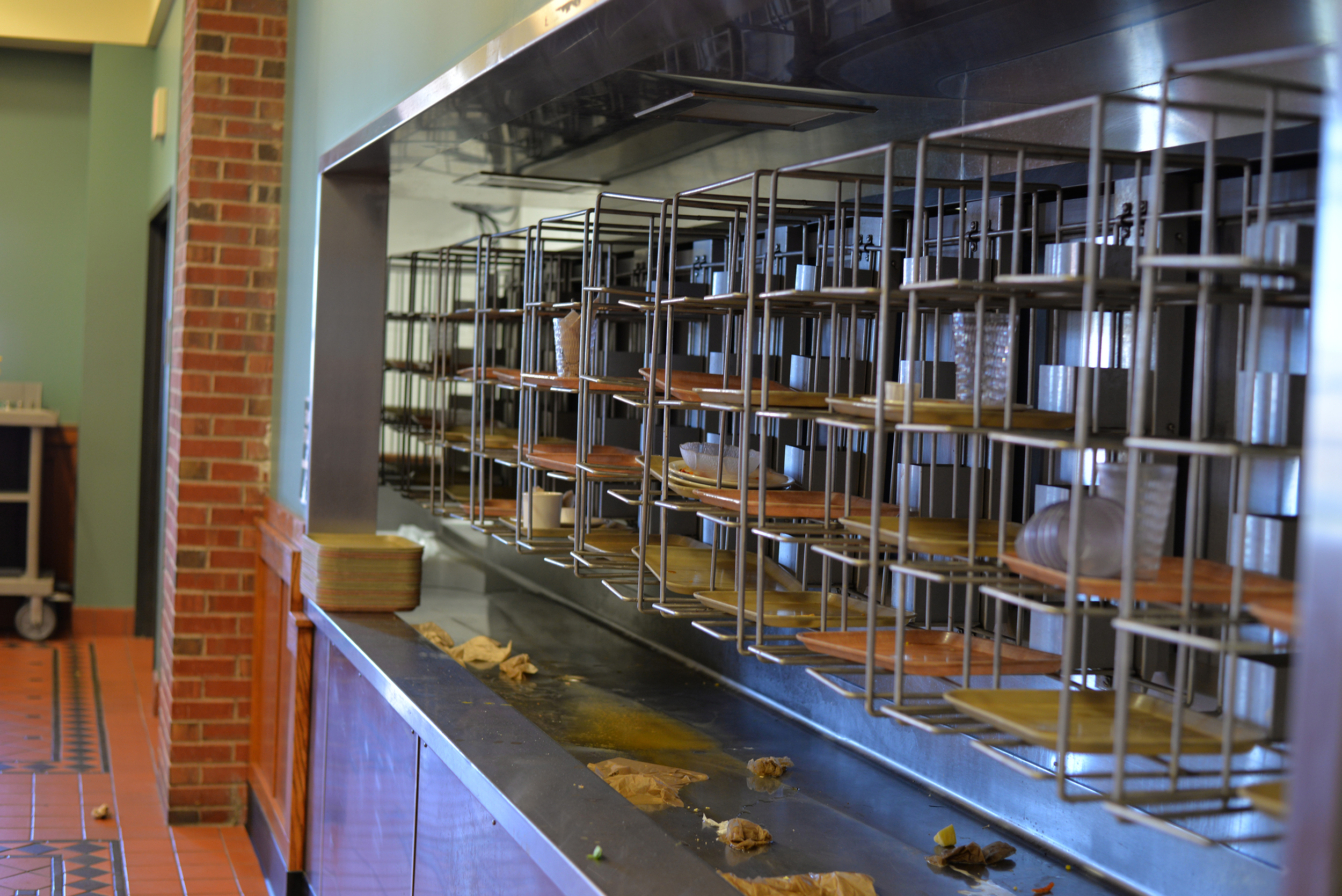 Empty trains containing plates and food waste sit on a rack in the South Campus dining hall on the UConn campus in Storrs, Connecticut. (File Photo/The Daily Campus)