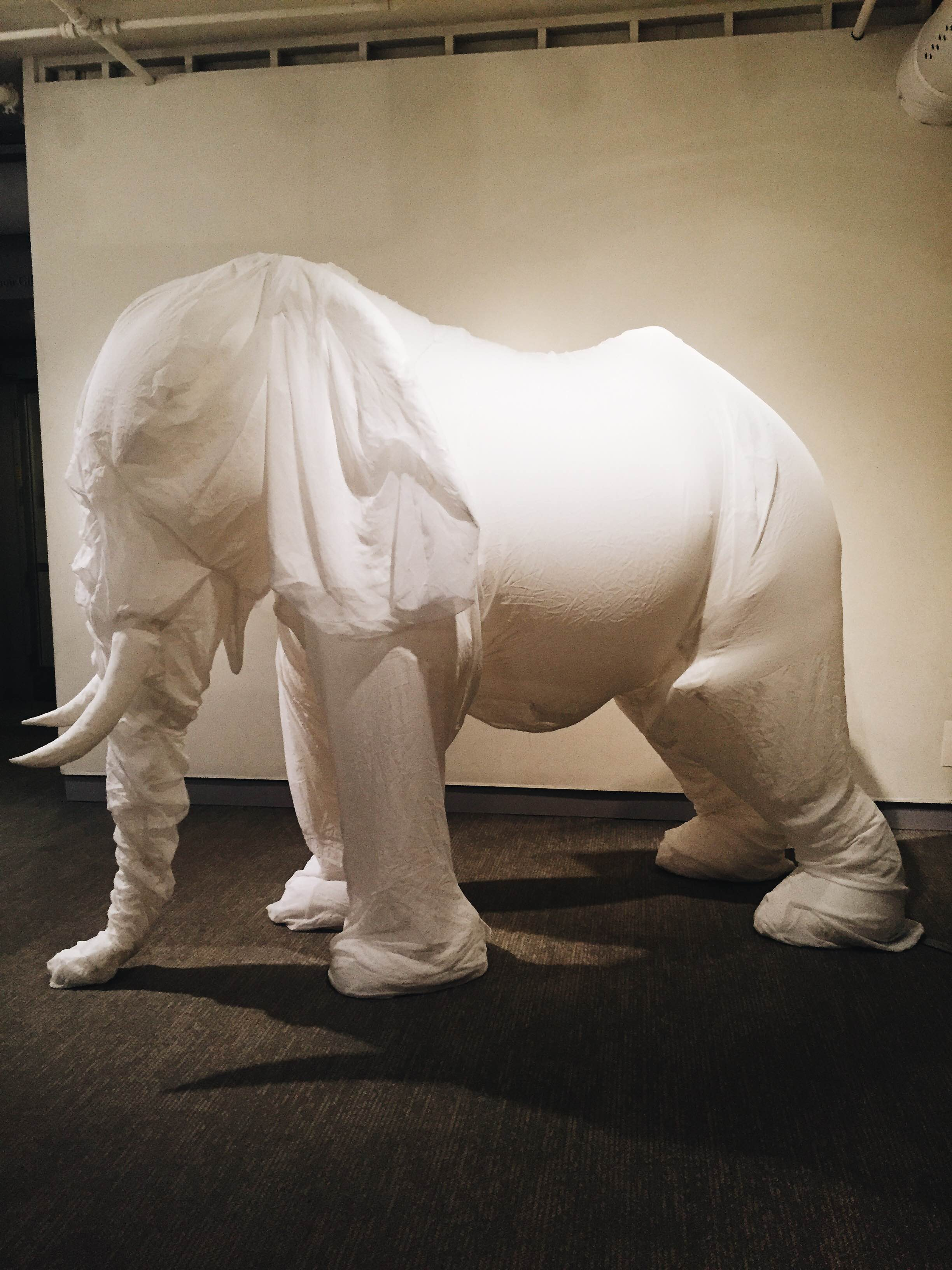"""A 10-feet-tall piece titled """"White Elephant I"""" by Billie Grace Lynn. It is composed of rip stop nylon, chiffon and an electric fan. (Megan Krementowski/The Daily Campus)"""