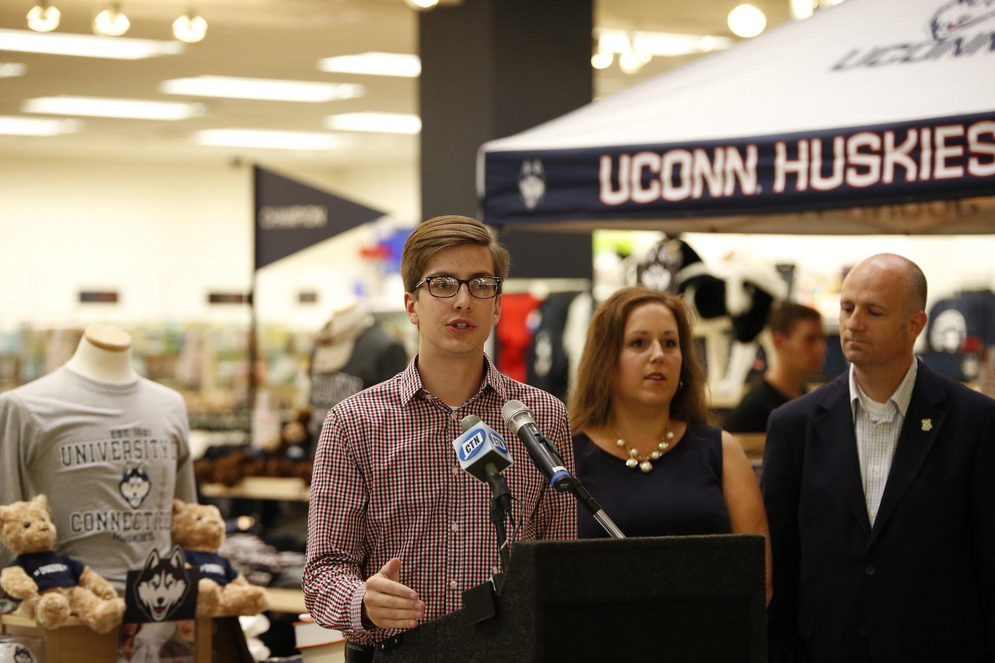 Undergraduate Student Government President Dan Byrd speaks at the UConn Bookstore press conference regarding open source textbooks on Tues., Sept. 6. State Representative Gregg Haddad (D-Mansfield) and Senator Mae Flexer (D- Killingly)were in attendance. (Tyler Benton/The Daily Campus)