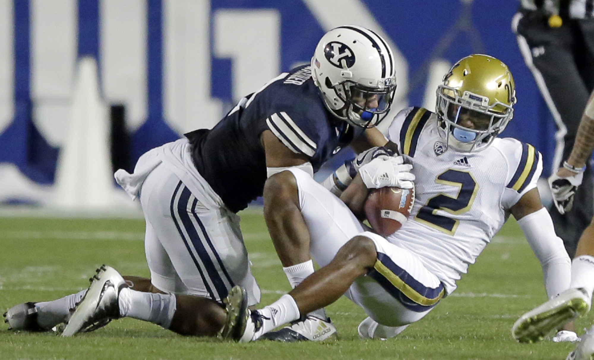 BYU linebacker Fred Warner, left, tackles UCLA wide receiver Jordan Lasley during the first half of an NCAA college football game Saturday, Sept. 17, 2016, in Provo, Utah. (AP Photo/Rick Bowmer)