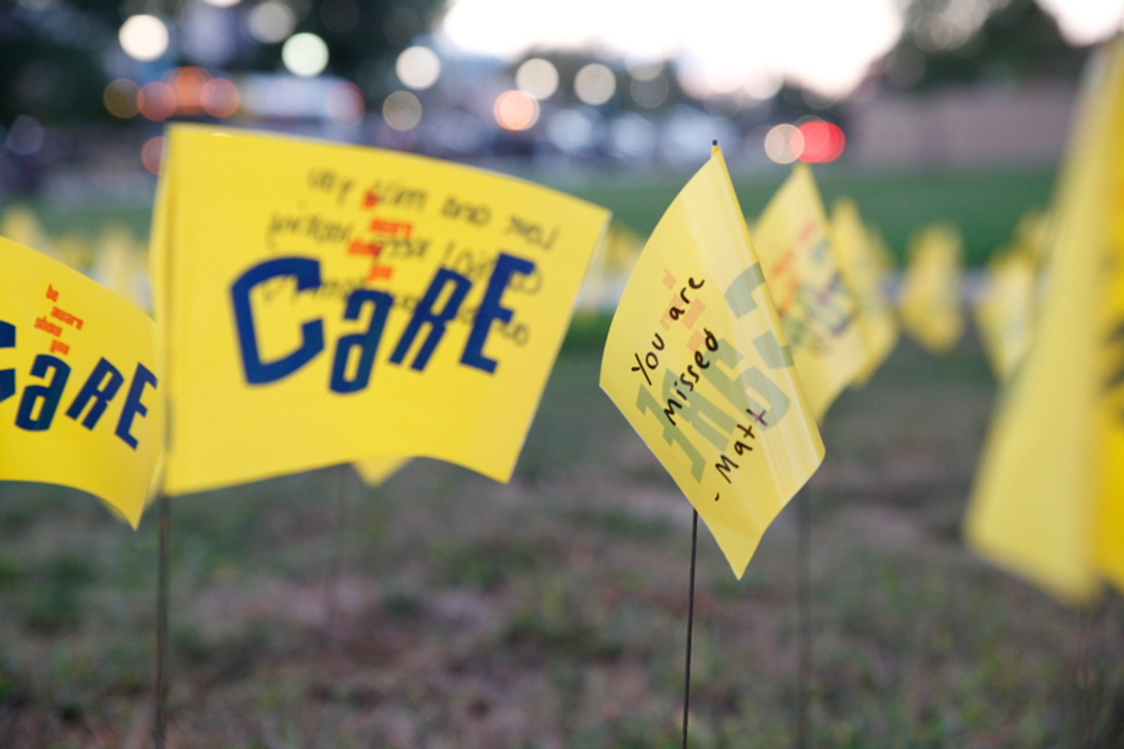 Yellow flags were placed around Fairfield Way to represent the students in the United States that pass away each year from suicide. (Tyler Benton/The Daily Campus)