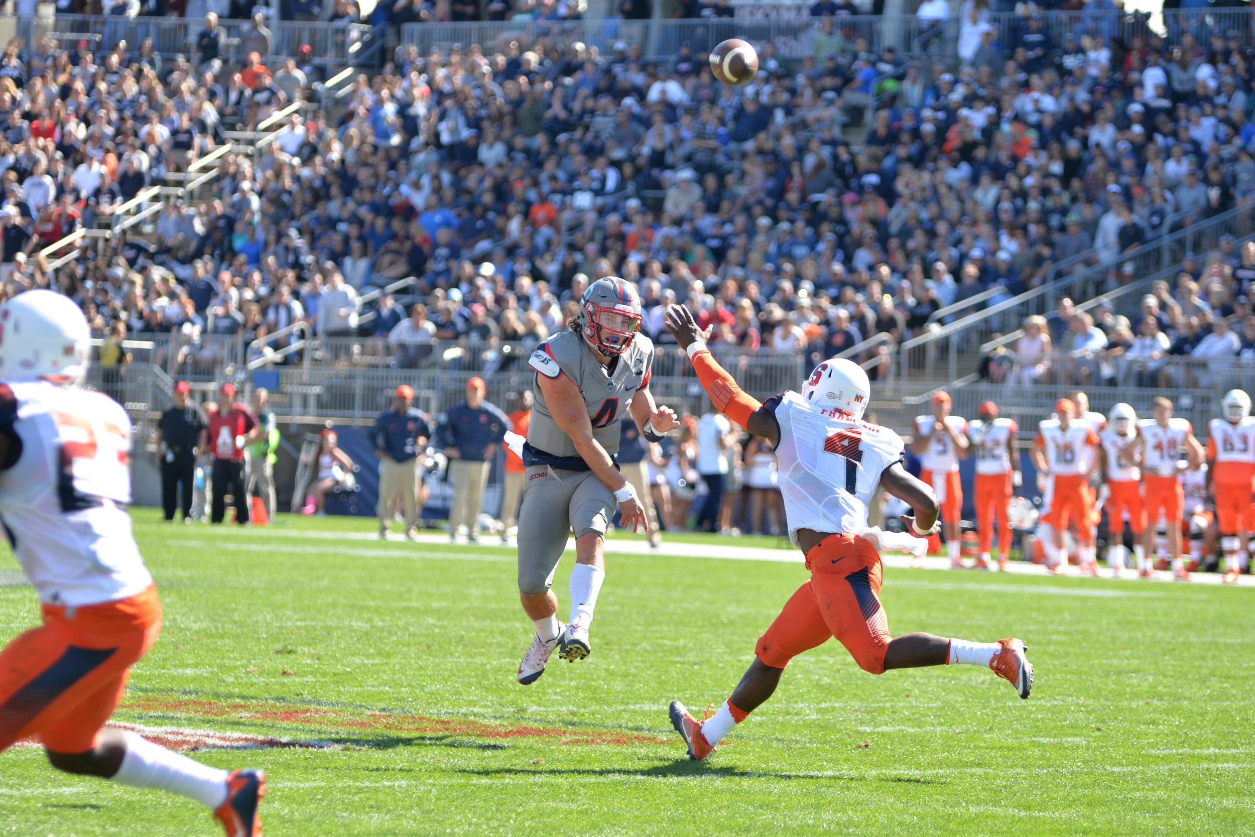 Bryan Shirreffs throws a pass during UConn's game against Syracuse. (Jackson Haggis/The Daily Campus)