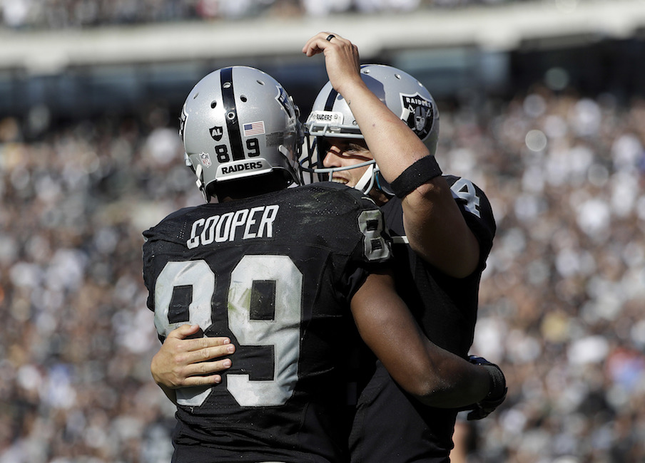 Oakland Raiders wide receiver Amari Cooper (89) and quarterback Derek Carr celebrate after connecting on a touchdown pass against the San Diego Chargers during the second half of an NFL football game in Oakland, Calif., Sunday, Oct. 9, 2016. (Marcio Jose Sanchez/AP)