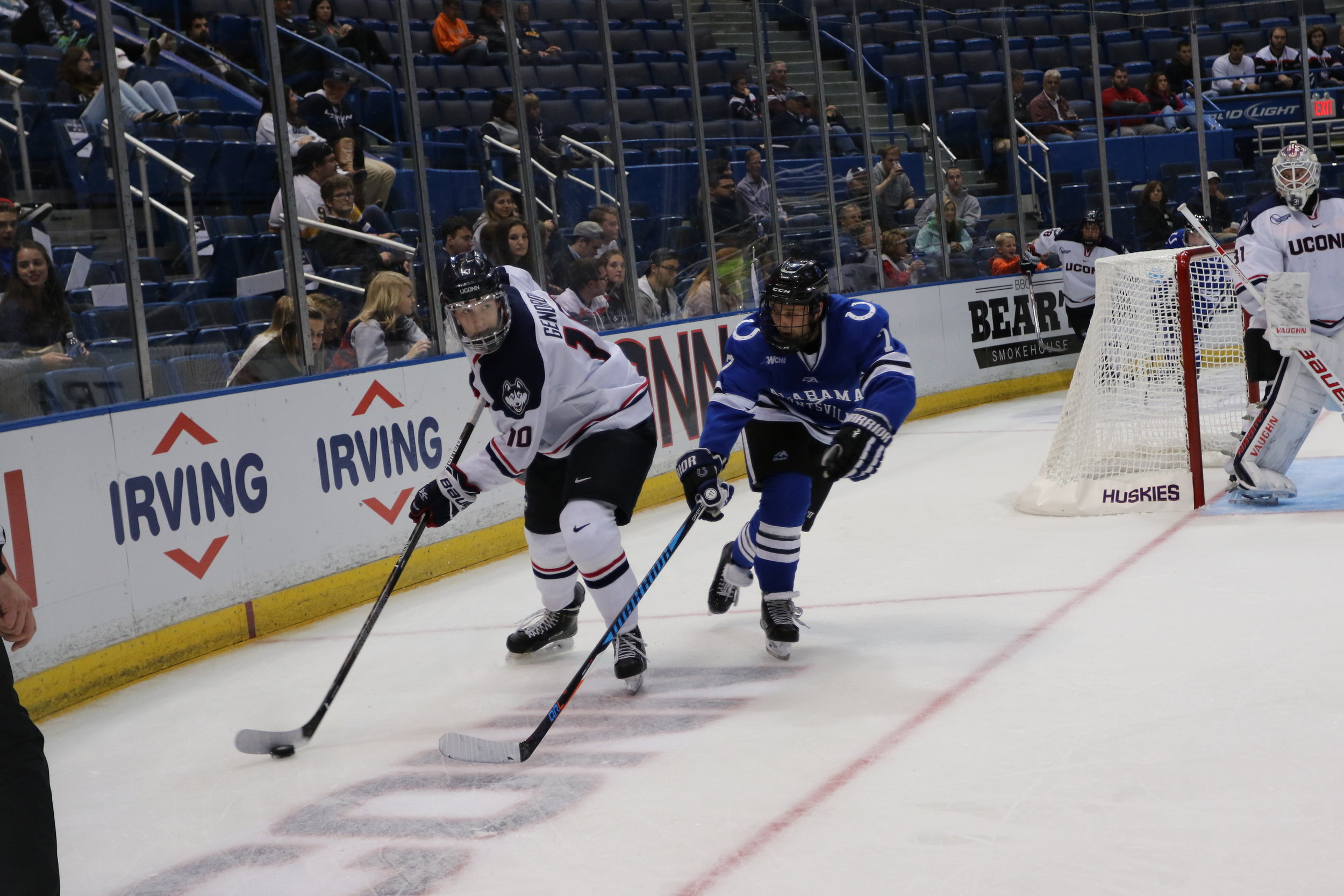 Sophomore defenseman Miles Gendron (#10) evades an Alabama-Huntsville defender as goaltender Rob Nichols (#31) looks on during the Huskies' second game of the weekend on Saturday Oct. 8, 2016 at the XL Center. The Huskies swept the weekend series outscoring the Chargers 10-0. (Ruohan Li/The Daily Campus)