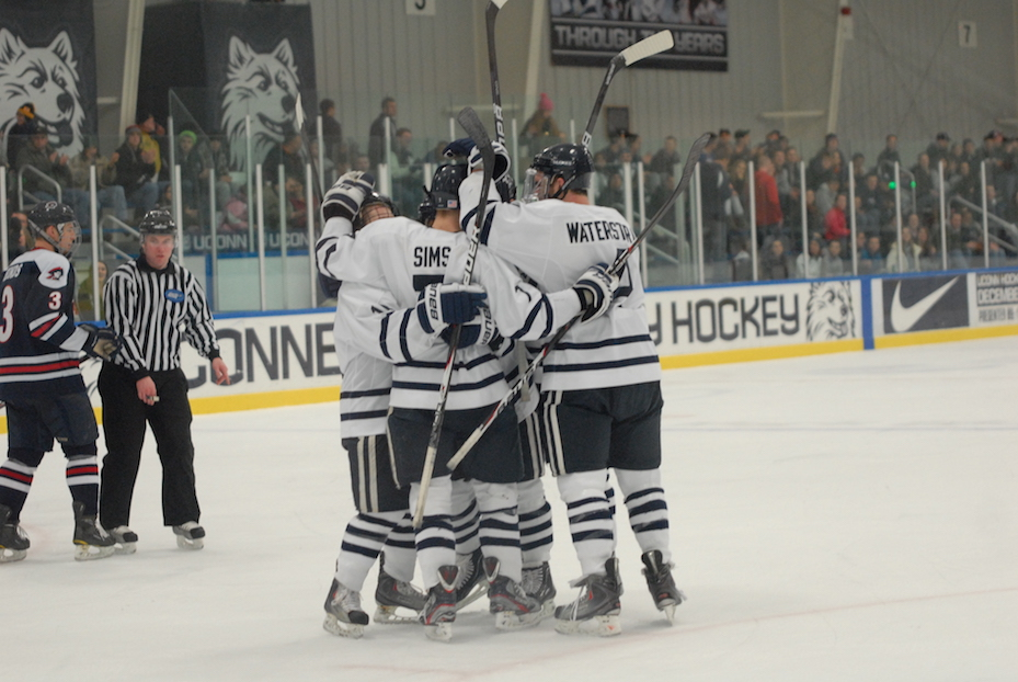 Bruce Marshall's Huskies celebrate a goal in a game against Robert Morris University on Jan. 20, 2012 at the Freitas Ice Forum. Marshall, a former player and head coach for UConn, passed away Saturday morning. (File photo)
