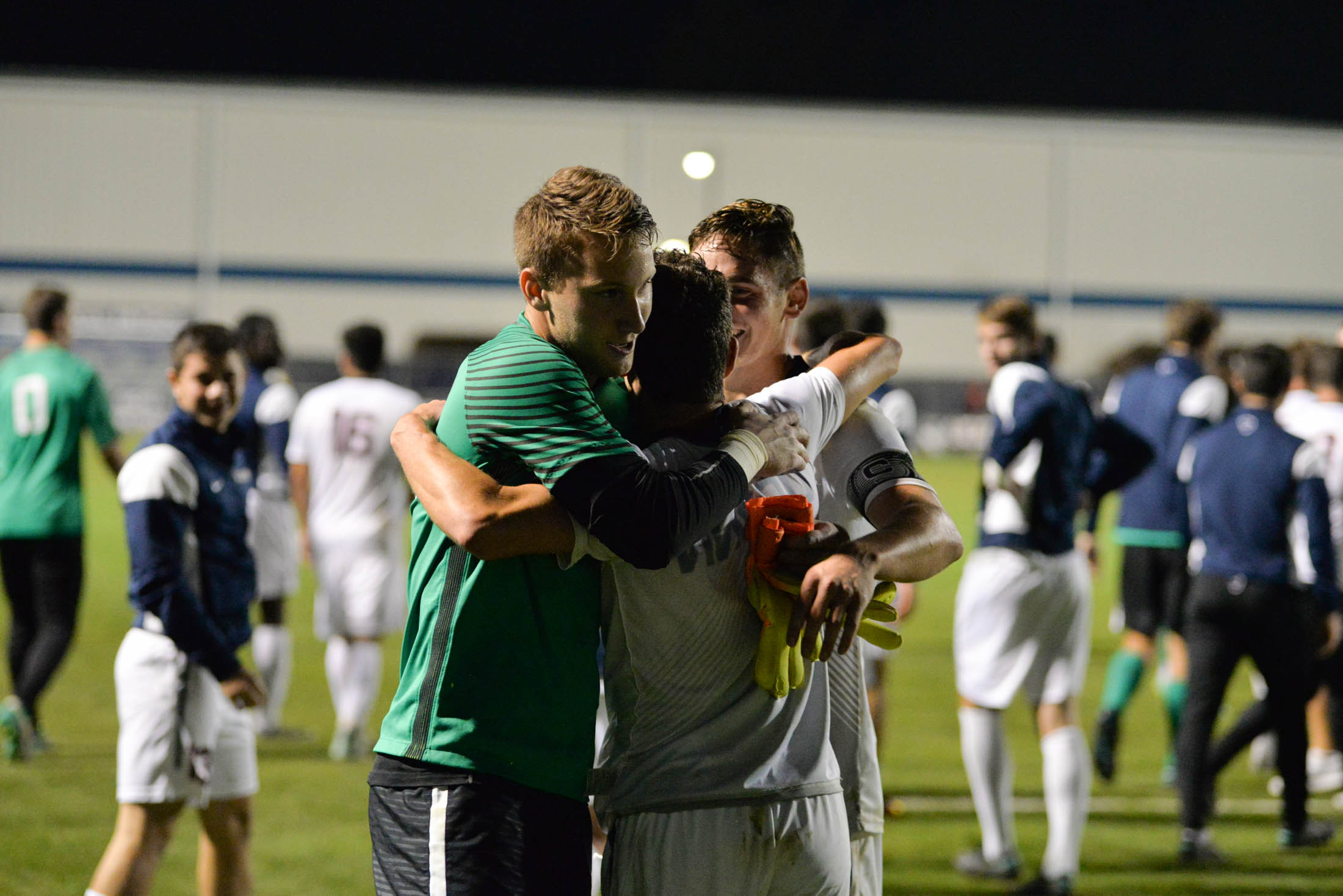 (from left to right) Goalkeeper Scott Levene, defender Dylan Greenberg and defender-captain Jake Newinski hug following the Huskies 1-0 overtime victory over Boston College on Tuesday, Oct. 18, 2016 at Morrone Stadium. Greenberg scored the game winning goal for the Huskies. (Amar Batra/The Daily campus)