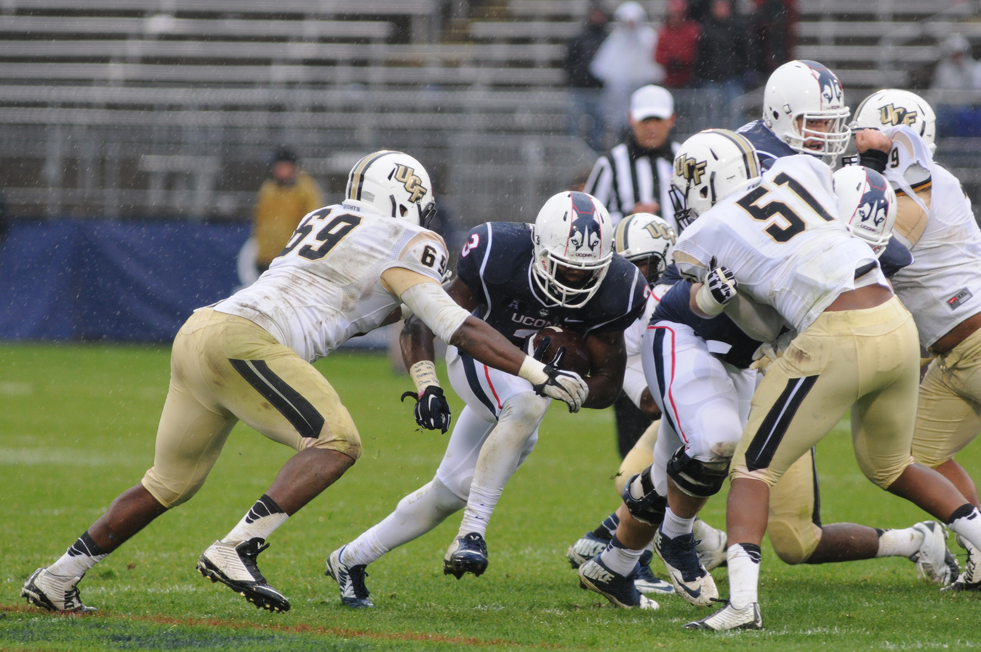 UConn running back Ron Johnson (3) against UCF defensive Thomas Niles (69) and Chris Larsen (51) at Rentschler Field Nov. 1, 2014. UConn plays UCF on Saturday in what head coach Bob Diaco has deemed the Civil Conflict.(Troy Caldeira/ The Daily Campus)