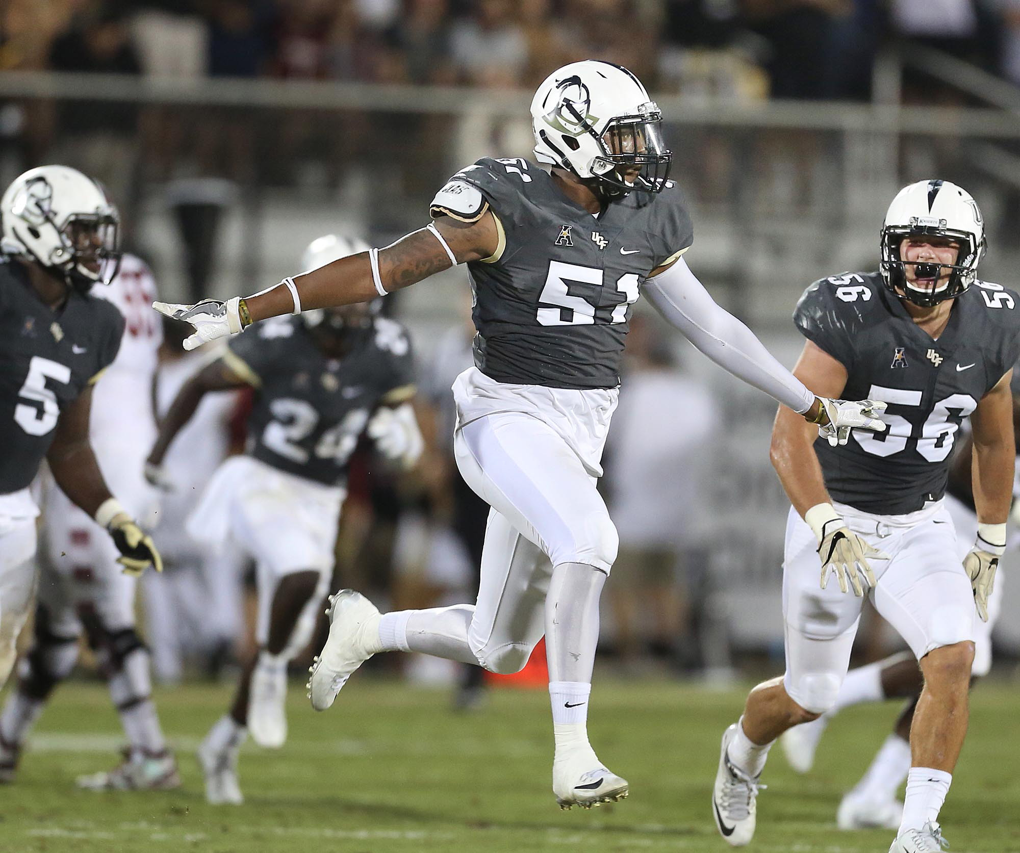 Central Florida linebacker Errol Clarke (51) celebrates after a stop against Temple during an NCAA college football game in Orlando, Fla., on Saturday, Oct. 15, 2016. (Stephen M. Dowell/AP)