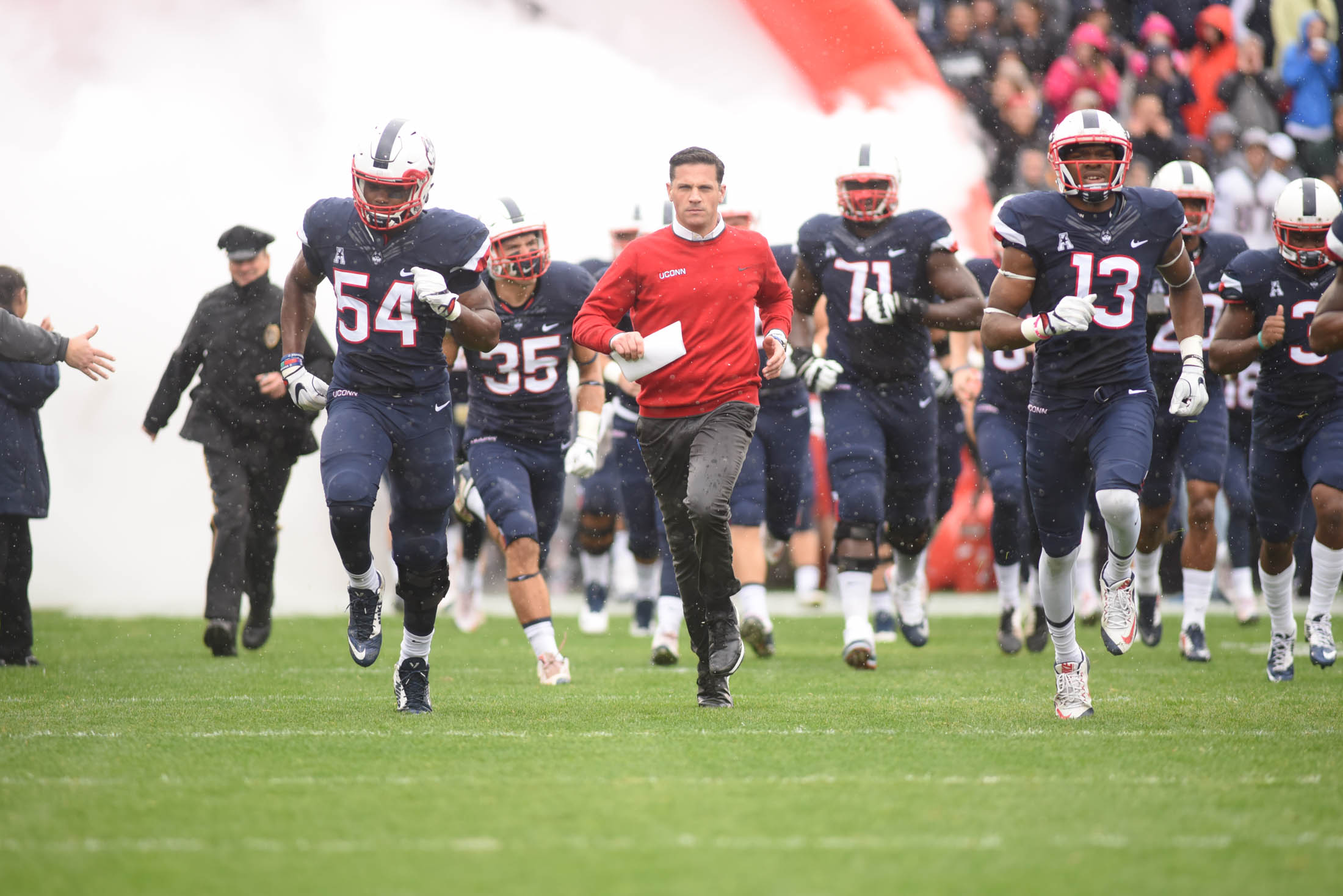 "Head coach Bob Diaco takes the field with his team ahead of the Huskies 24-16 loss to the UCF Knights during the ""Civil ConFLiCT"" on Saturday, Oct. 22, 2016 at Rentschler Field. Diaco addressed the importance and the end of the rivalry game at a press conference on Tuesday afternoon. (Zhelun Lang/The Daily Campus)"
