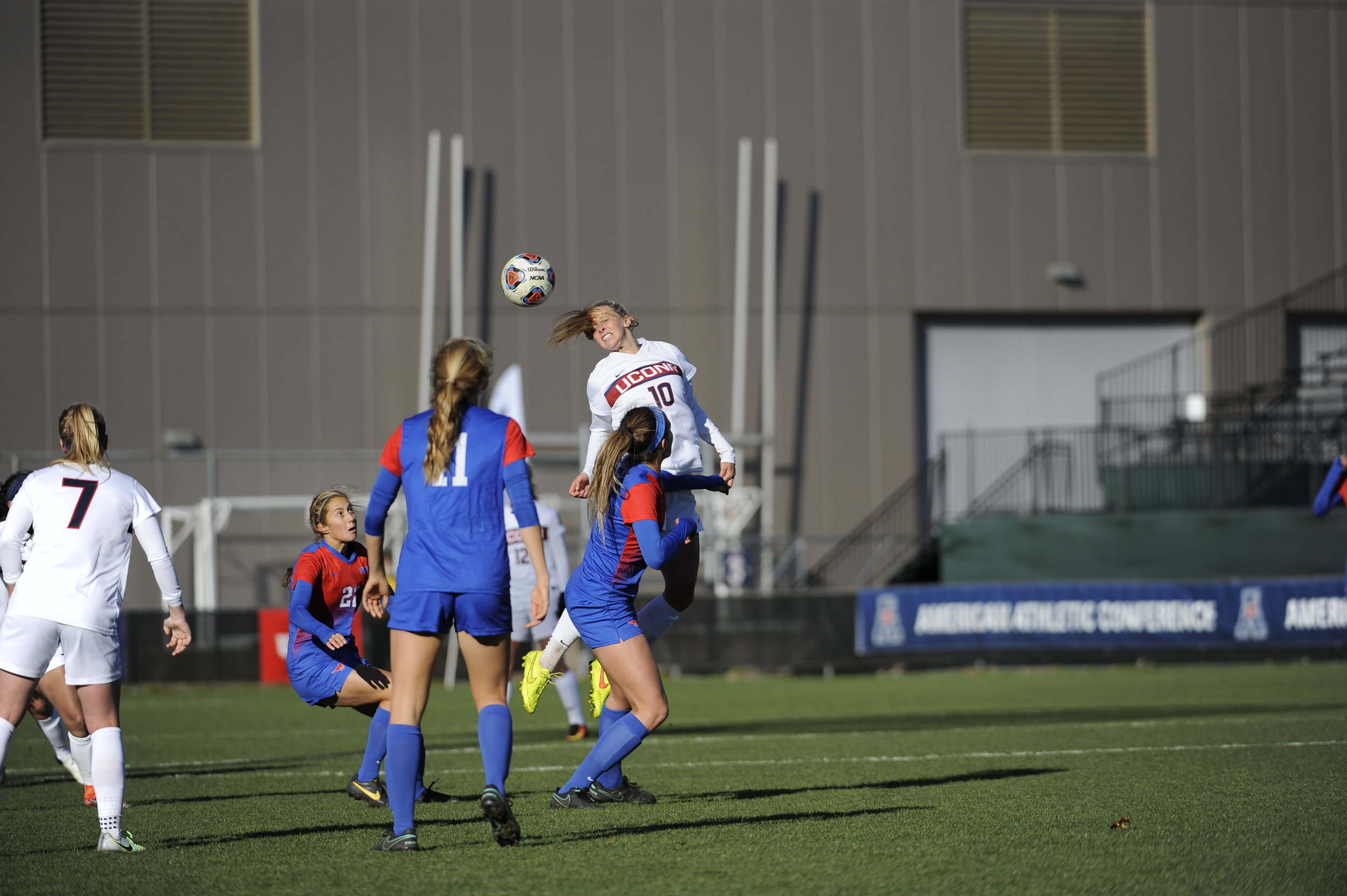 Redshirt freshman defender Annika Schmidt heads a ball over SMU players during a 1-0 win in the conference finals on Sunday, Nov. 6 at Joseph J. Morrone Stadium. Schmidt made her first start of the tournament, replacing Kristen Vinciguerra, who was ineigible to play after receiving a red card int he semifinals. (Jason Jiang/The Daily Campus)