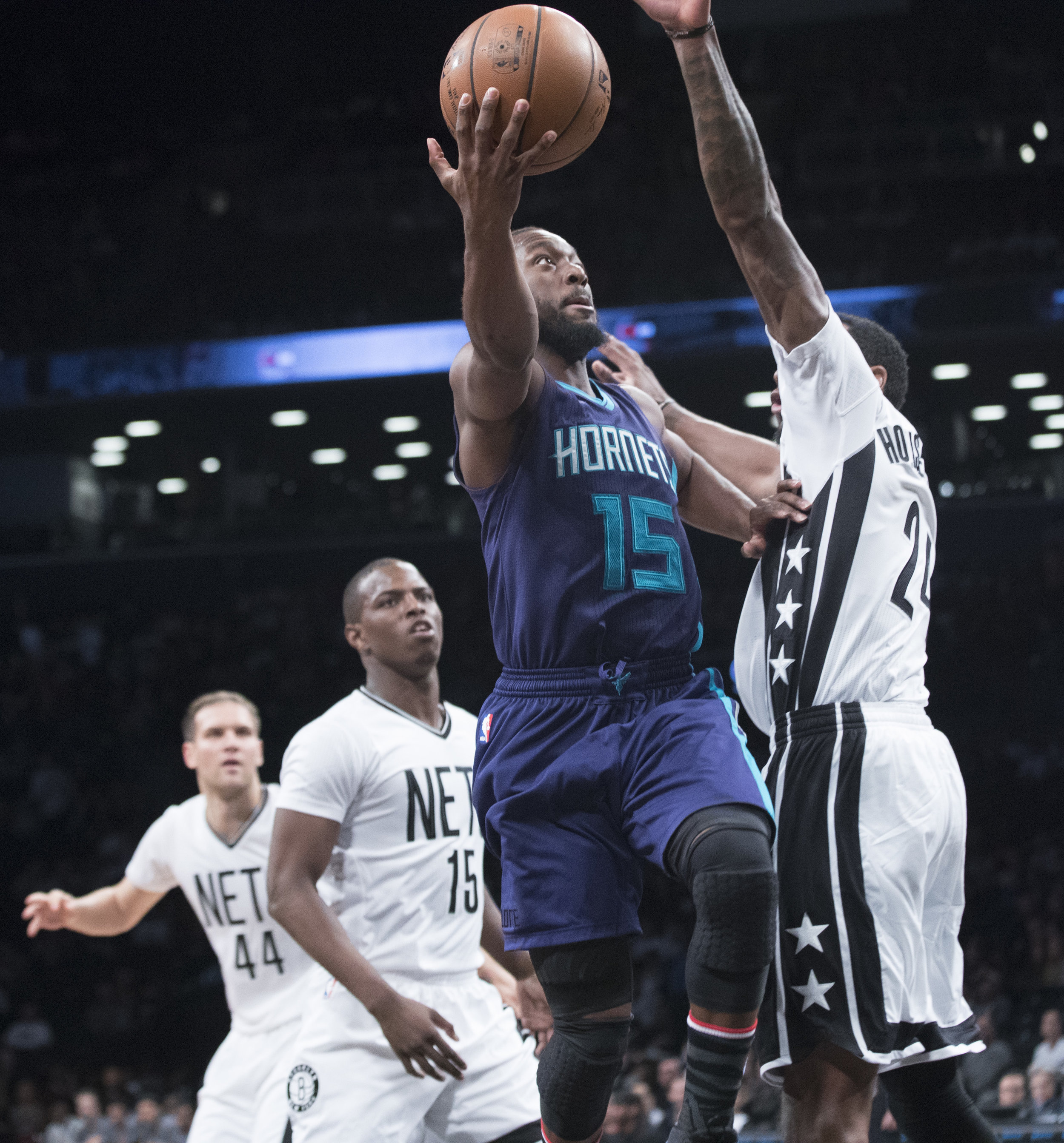 Charlotte Hornets guard Kemba Walker (15) goes to the basket past Brooklyn Nets guard Rondae Hollis-Jefferson (24) during the first half of an NBA basketball game, Friday, Nov. 4, 2016, in New York. (Mary Altaffer/AP Photo)