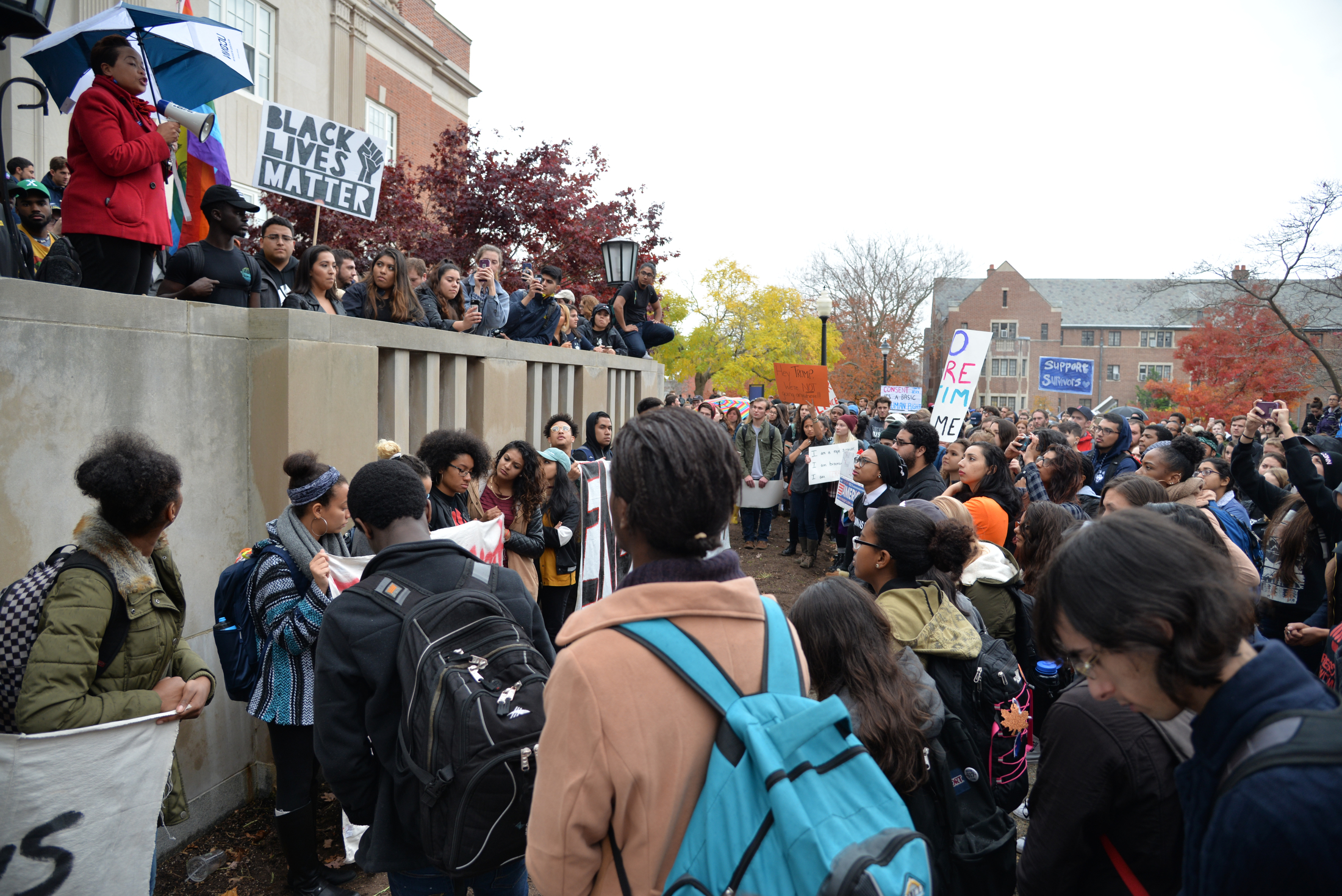 "UConn Chief Diversity Officer Joelle Murchison addresses students at the ""Rally for the People"" as rally organizer Eric Cruz Lopez looks on outside Wilbur Cross on Wednesday, Nov. 9, 2016. The rally was organized by undocumented students at the university to protest the election results. (Amar Batra/The Daily Campus)"