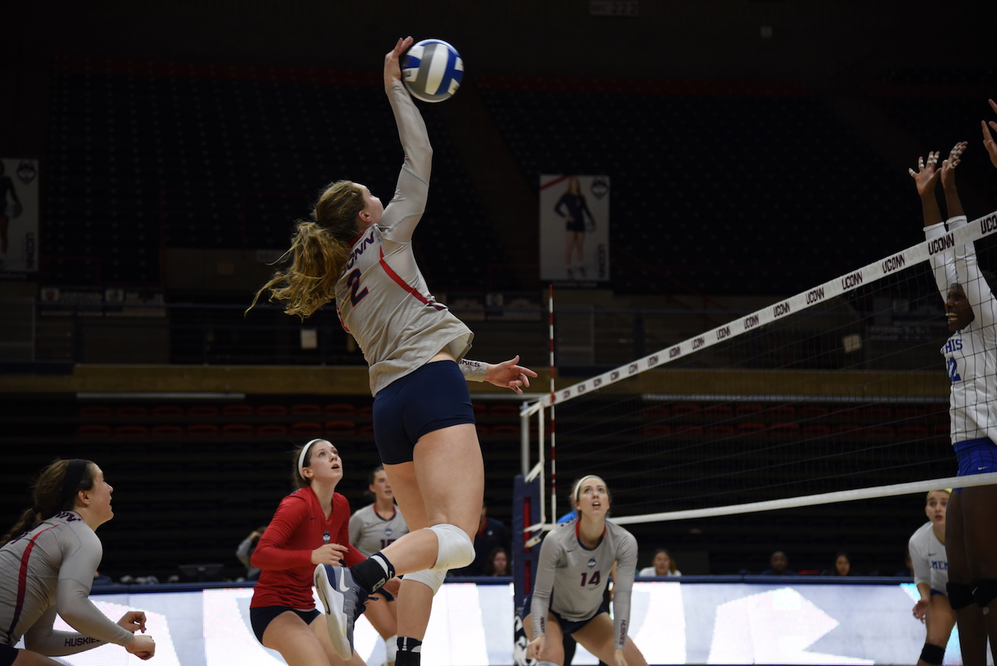 Outside hitter Danielle Cabel spikes the ball in an October 30th game against Memphis. The Huskies won 3-0. (Charlotte Lao/The Daily Campus)