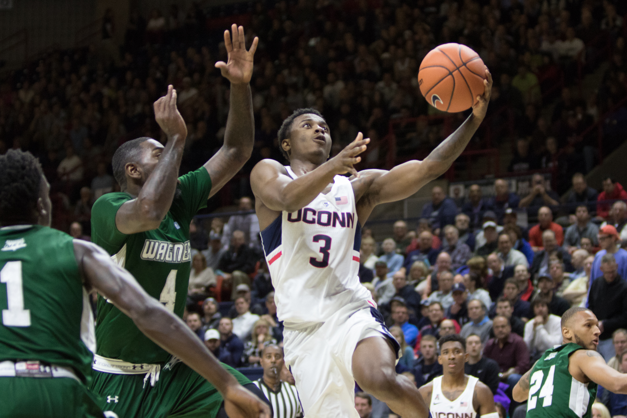 Freshman guard Alterique Gilbert goes up for a layup during the Huskies' 67-58 loss to Wagner on Friday, Nov. 11 at Gampel Pavilion. Gilbert scored 14 points in his first game as a Husky. (Jackson Haigis/The Daily Campus)