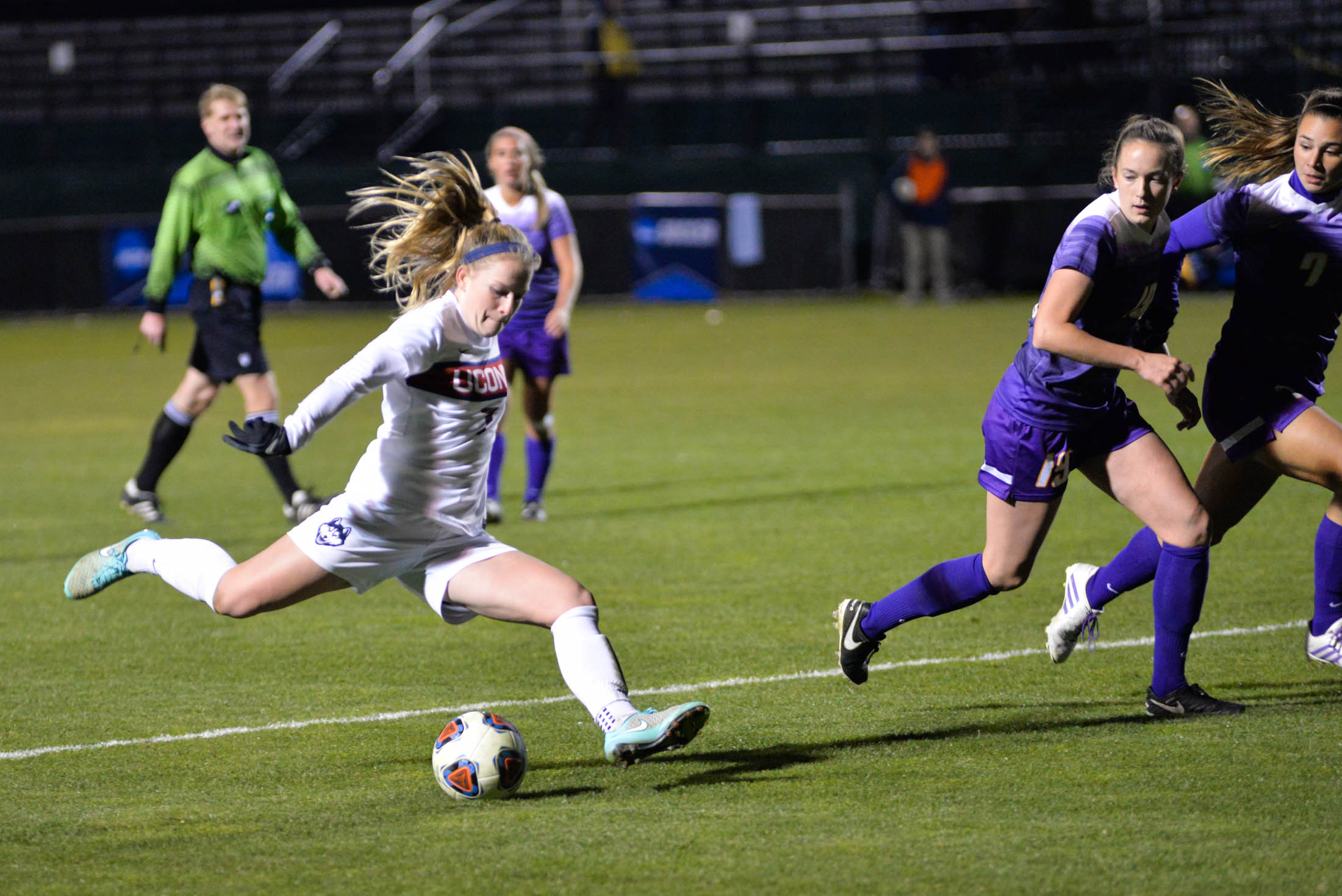 Senior midfielder Maddie Damm (7) fires off a goal during the Huskies 4-2 victory over the UAlbany Great Danes during the first round of the NCAA tournament on Saturday, Nov. 12, 2016. This is Damm's second goal of the season. (Amar Batra/The Daily Campus)