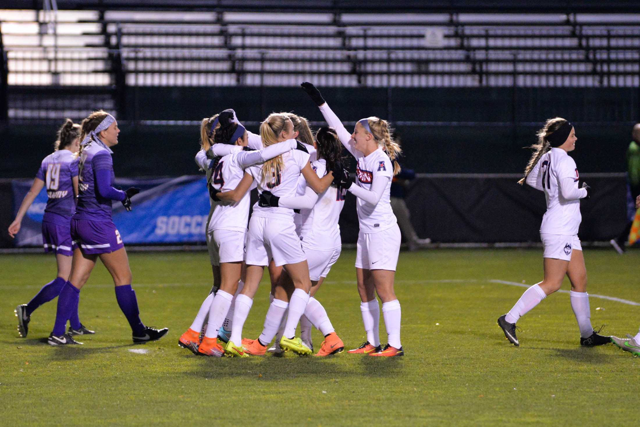 The team celebrates following midfielder Alexa Casmiro's (4) opening goal of the Huskies 4-2 victory over UAlbany in the first round of the NCAA tournament at Morrone Stadium on Saturday, Nov. 12, 2016. (Amar Batra/The Daily Campus)