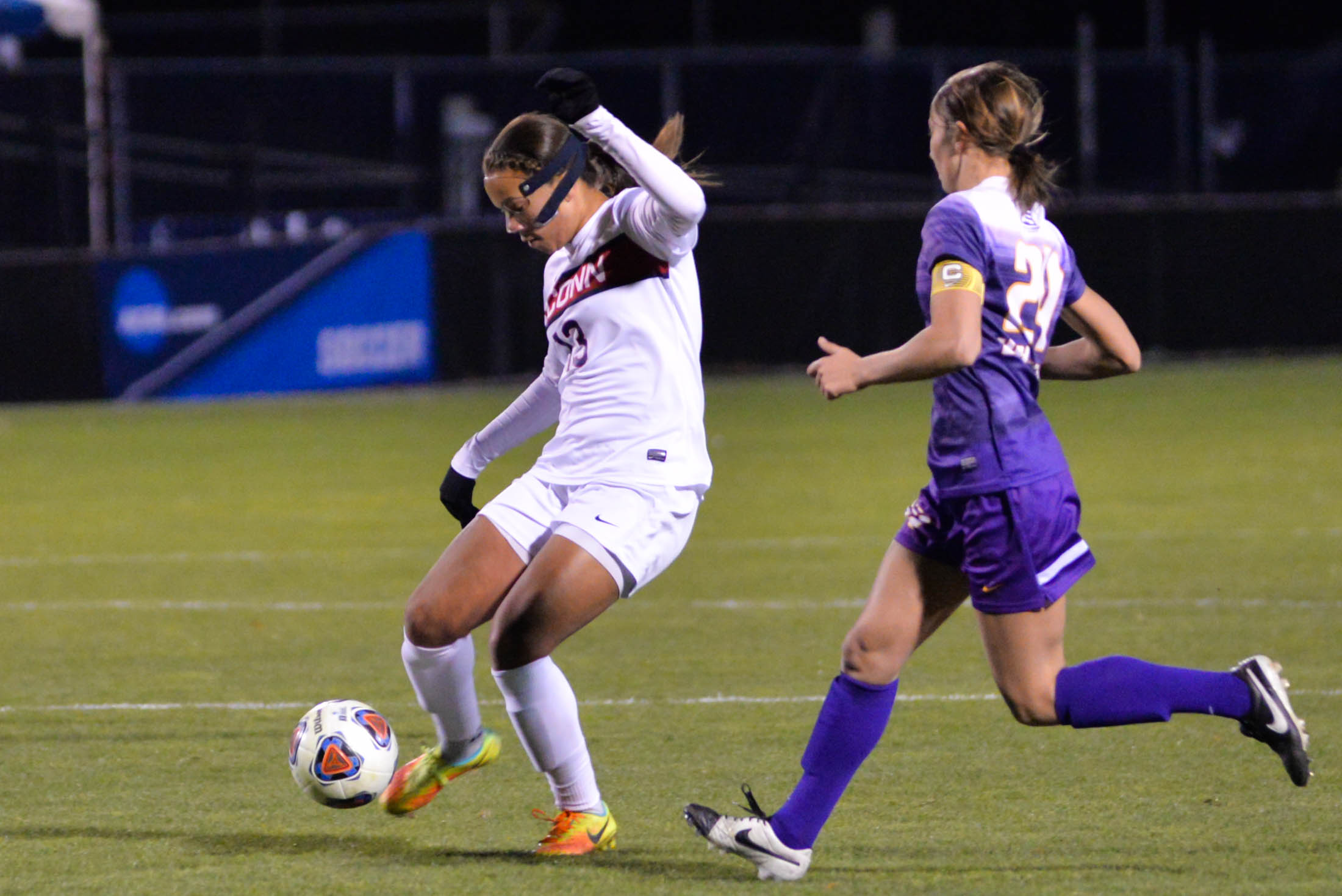 Defender Toriana Patterson (13) avoids UAlbany midfielder Caitlyn Paltsois (24) during the Huskies 4-2 victory over the Great Danes at Morrone Stadium on Saturday, Nov. 12, 2016. (Amar Batra/The Daily Campus)
