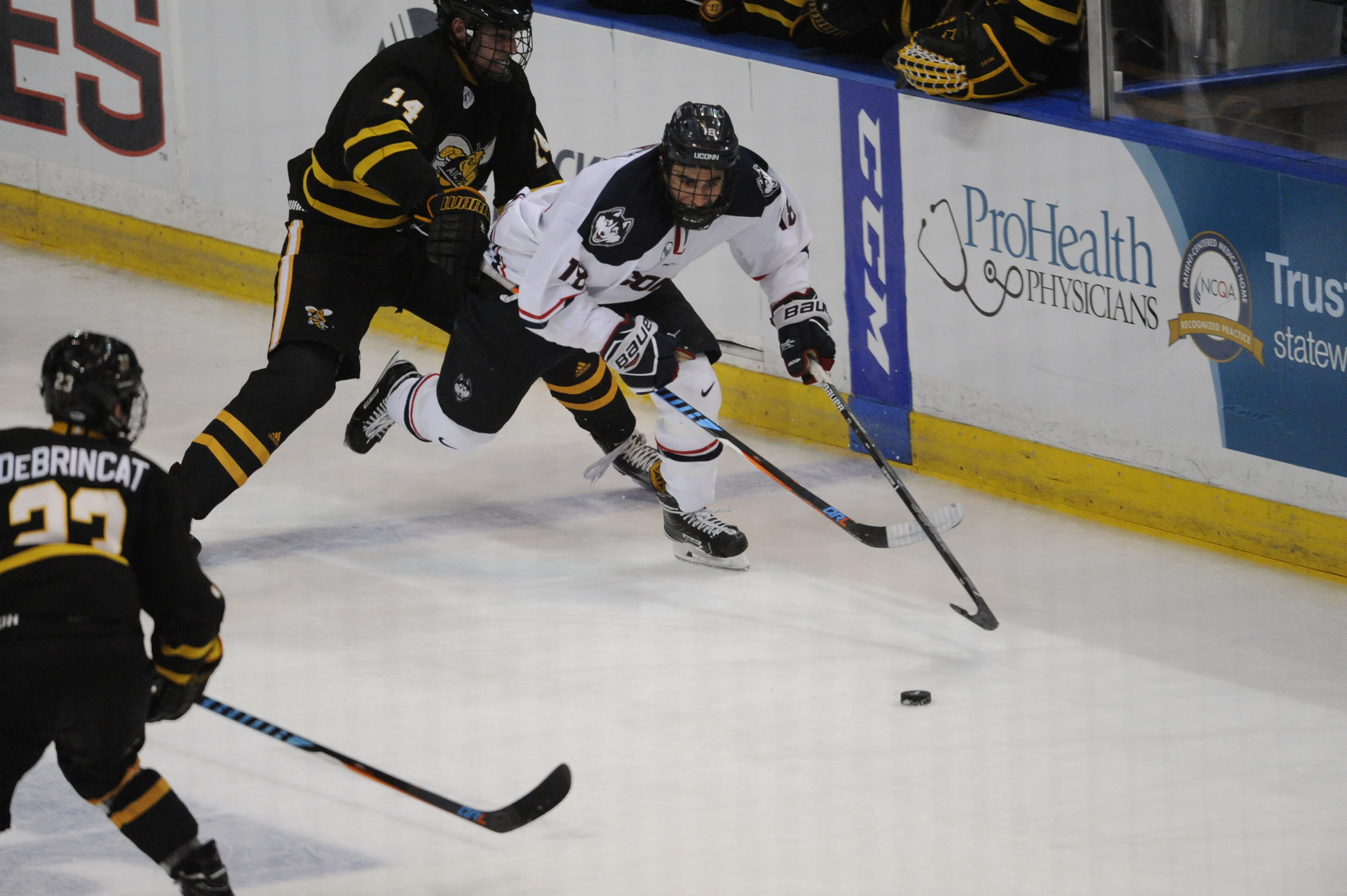 Forward Max Kelter (18) avoids forward Jared Pike (14) during the Huskies 2-2 tie against the AIC Hornets on Oct. 23, 2016 at the XL Center in Hartford, CT. (Jason Jiang/The Daily Campus)
