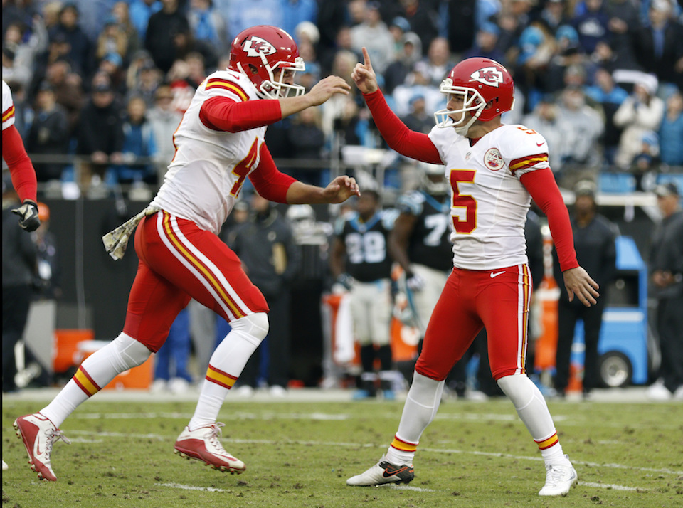 Kansas City Chiefs' Cairo Santos (5) celebrates with teammate James Winchester (41) after kicking the game-winning field goal against the Carolina Panthers in the final second of the second half of an NFL football game in Charlotte, N.C., Sunday, Nov. 13, 2016. (Bob Leverone/AP Photo)