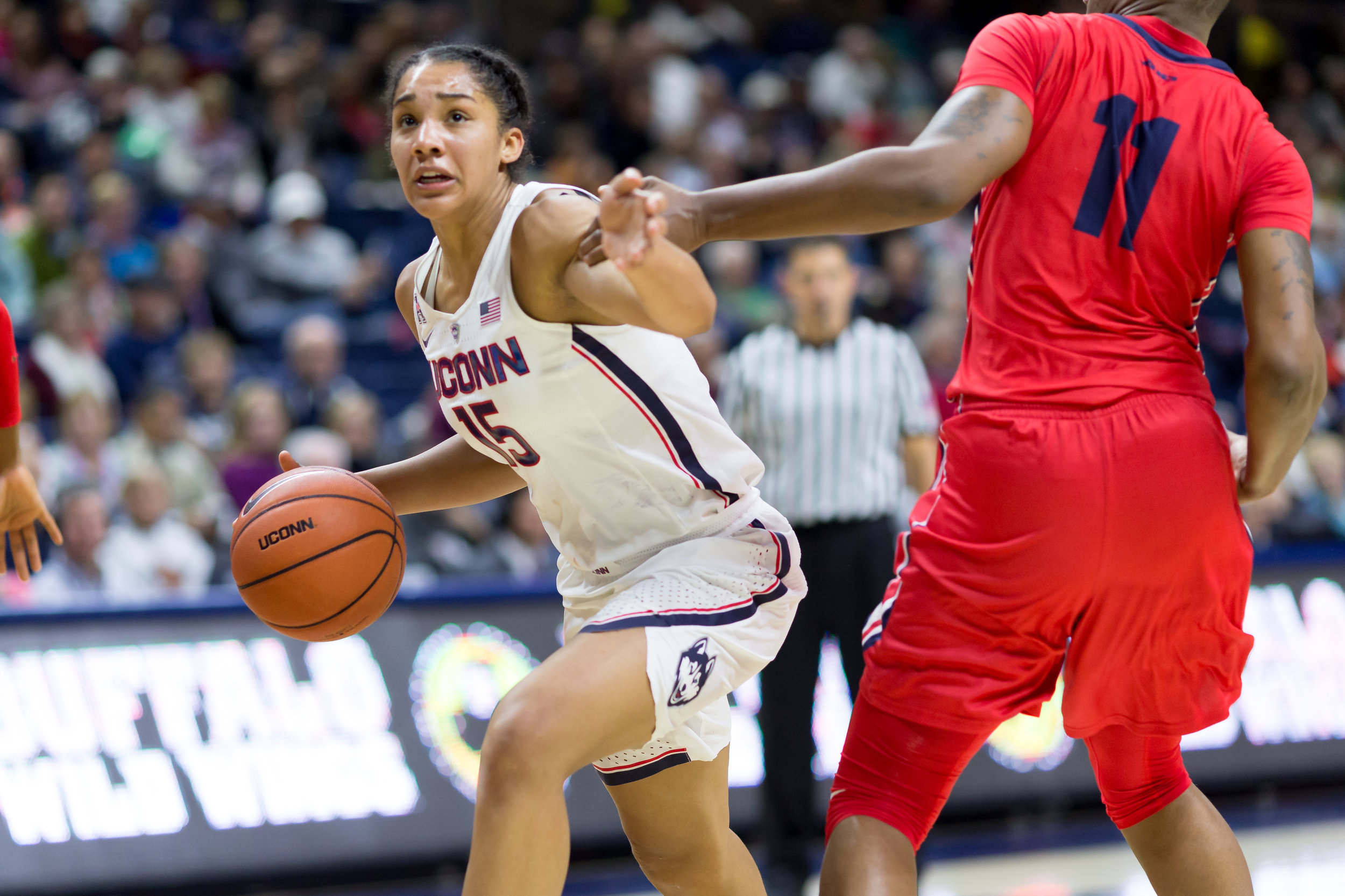 UConn's Gabby Williams dribbles past Dayton's Alex Harris in the Huskies 98-65 win on Nov. 22, 2016 at Gampel Pavilion. (Tyler Benton/The Daily Campus)