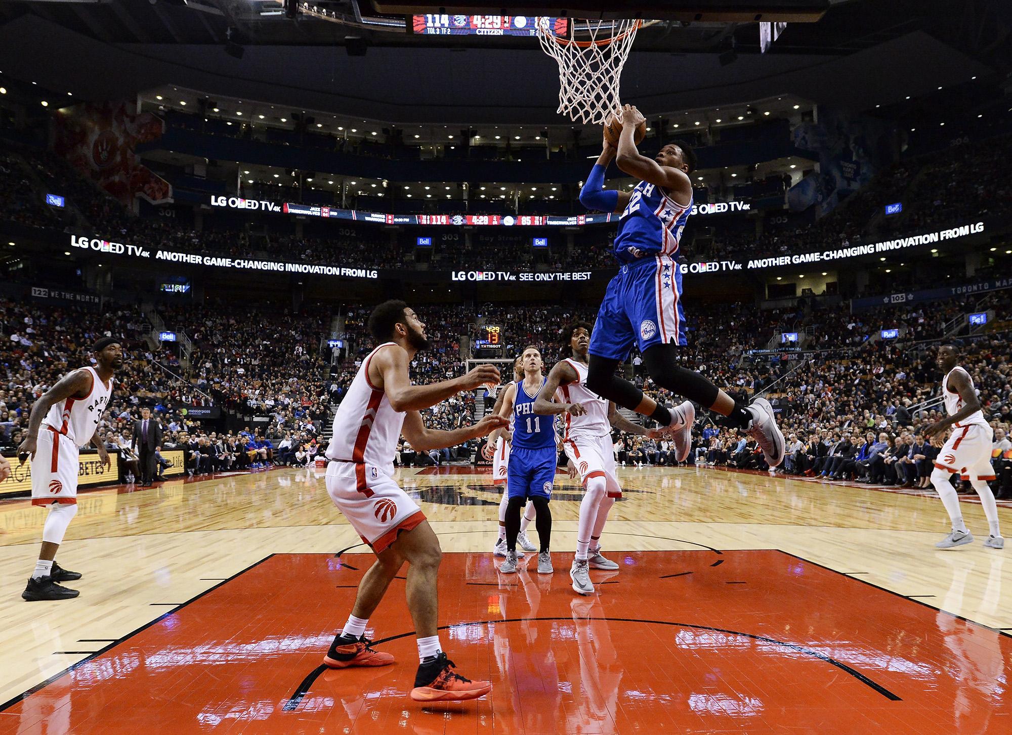 Philadelphia  76ers forward Richaun Holmes (22) goes up for a dunk shot past Toronto Raptors guard Cory Joseph (6) during the second half of an NBA basketball game in Toronto on Monday, Nov. 28, 2016. (Nathan Denette/AP)