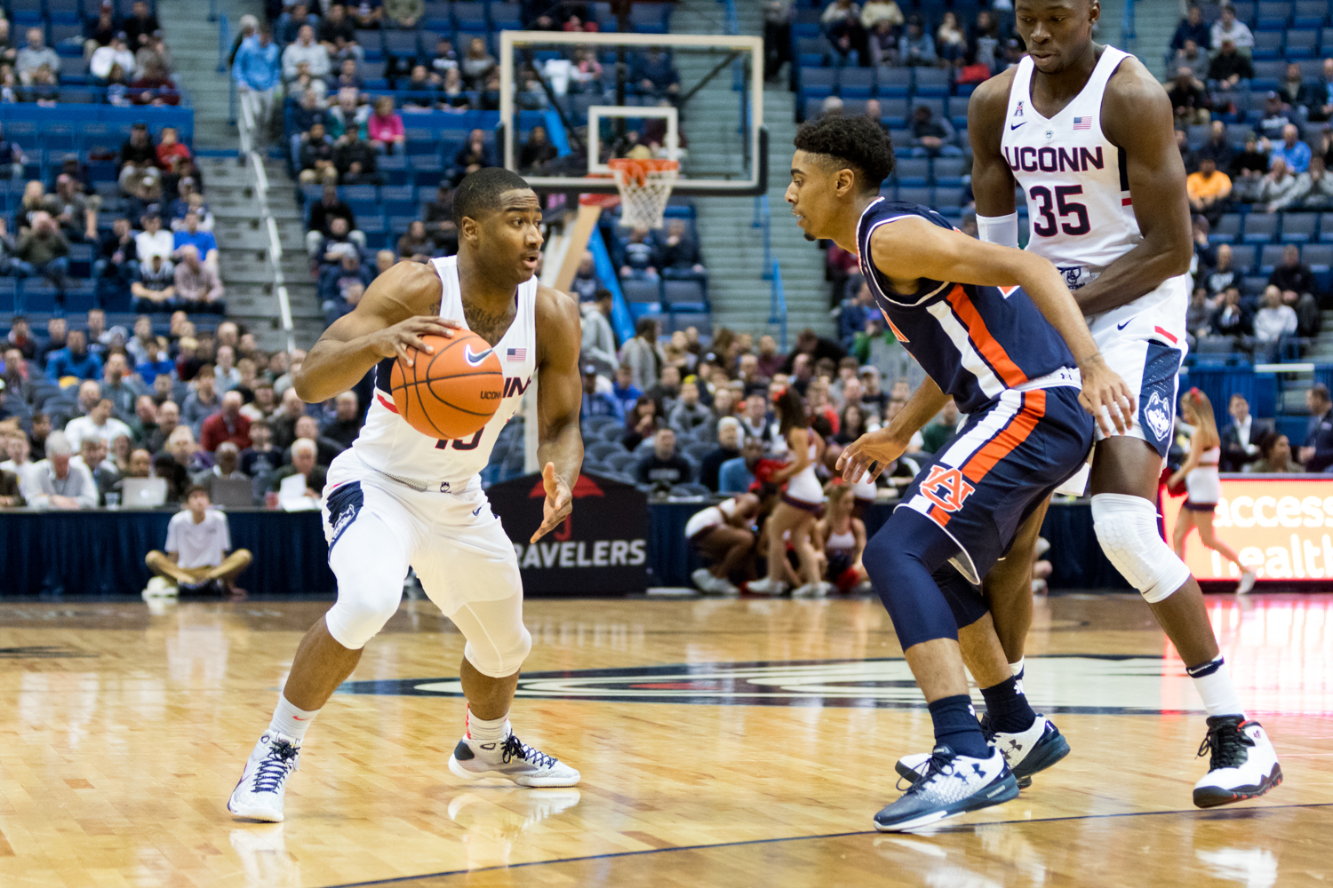 Rodney Purvis battles an Auburn defender with the help of Amida Brimah (35) during the Huskies' 70-67 overtime loss on Friday, Dec. 23 at the XL Center in Hartford. UConn returns to action there on Wednesday, Dec. 28 where they begin conference play against Houston. (Jackson Haigis/The Daily Campus)
