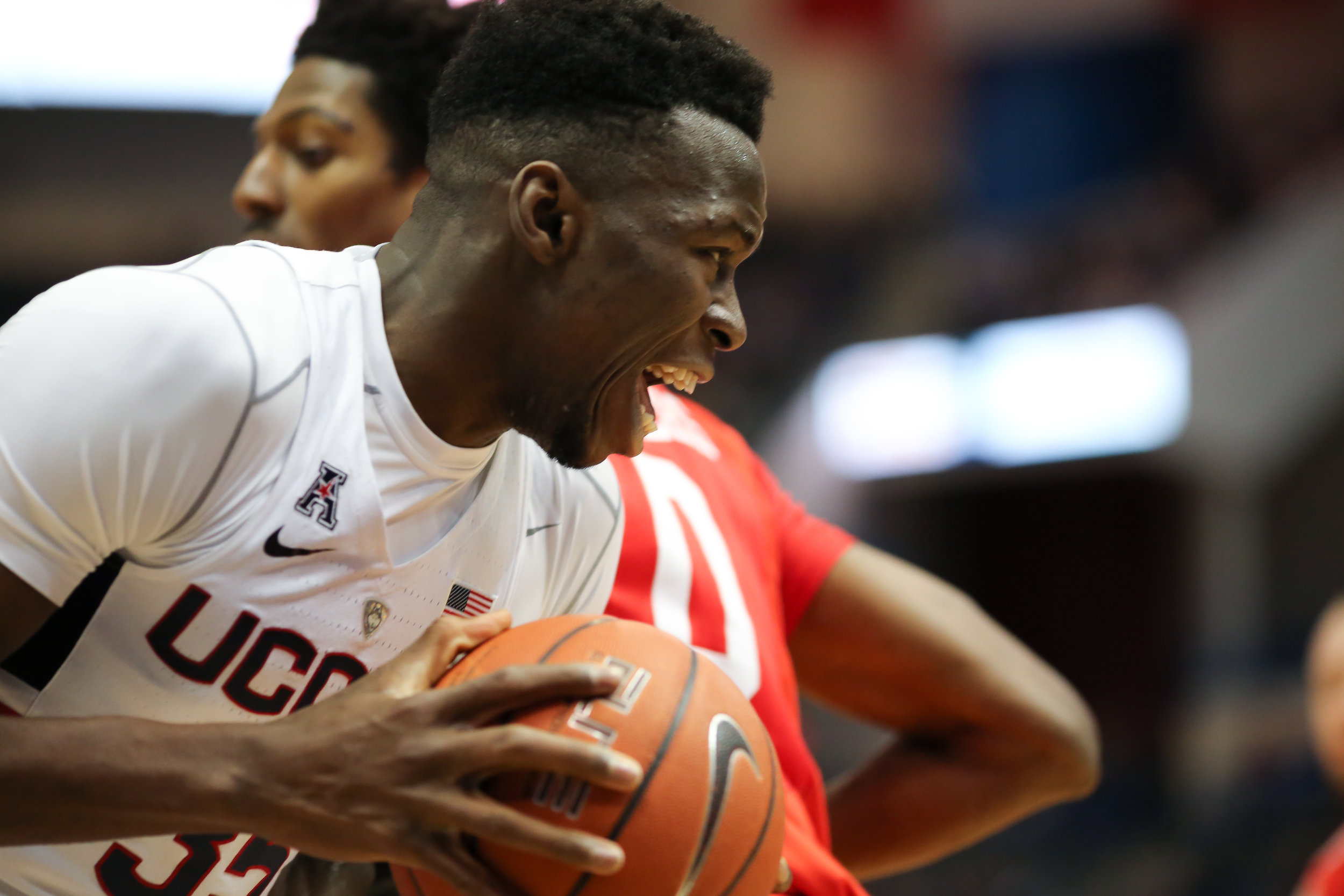 Amida Brimah controls the ball during UConn's 62-46 loss to Houston on Wednesday, Dec. 28 at the XL Center in Hartford. Brimah had six blocks and nine rebounds in Saturday's overtime loss. (Tyler Benton/The Daily Campus)