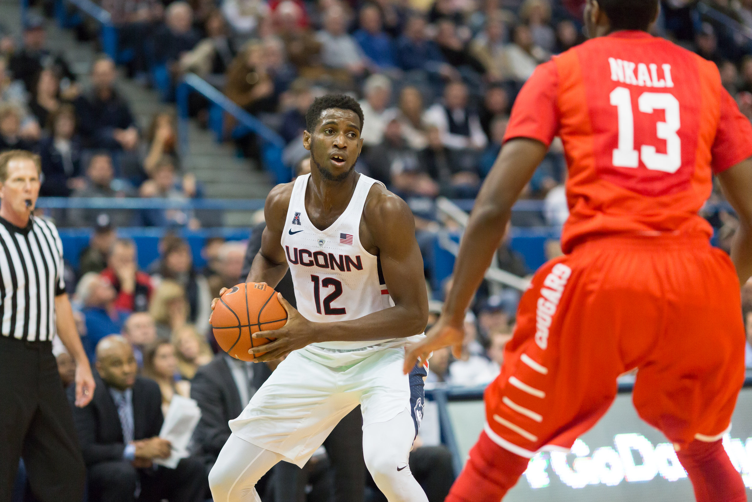 Kentan Facey looks to pass during UConn's 62-46 loss to Houston on Wednesday, Dec. 28, 2016 at the XL Center in Hartford. The Huskies will conclude their brief road stint when they take on Memphis at Memphis in search of their first conference win. (Tyler Benton/The Daily Campus)