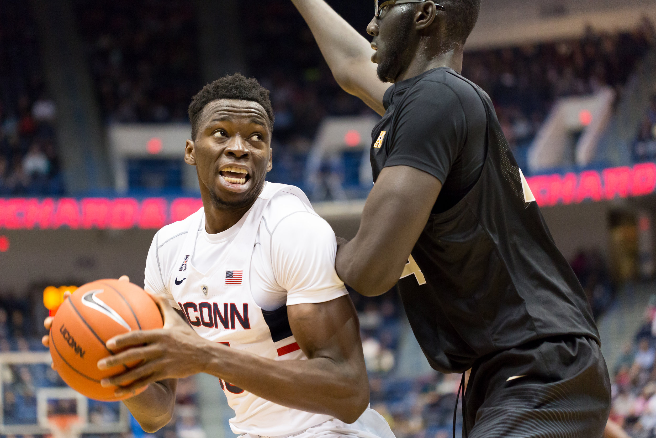 Amida Brimah goes up against 6-foot-7 Tacko Fall during UConn's 64-49 win over UCF on Sunday, Jan. 8, 2017 at the XL Center in Hartford. Brimah had nine points and five blocks in the victory and helped keep Fall at bay, holding him to zero points. (Tyler Benton/The Daily Campus)