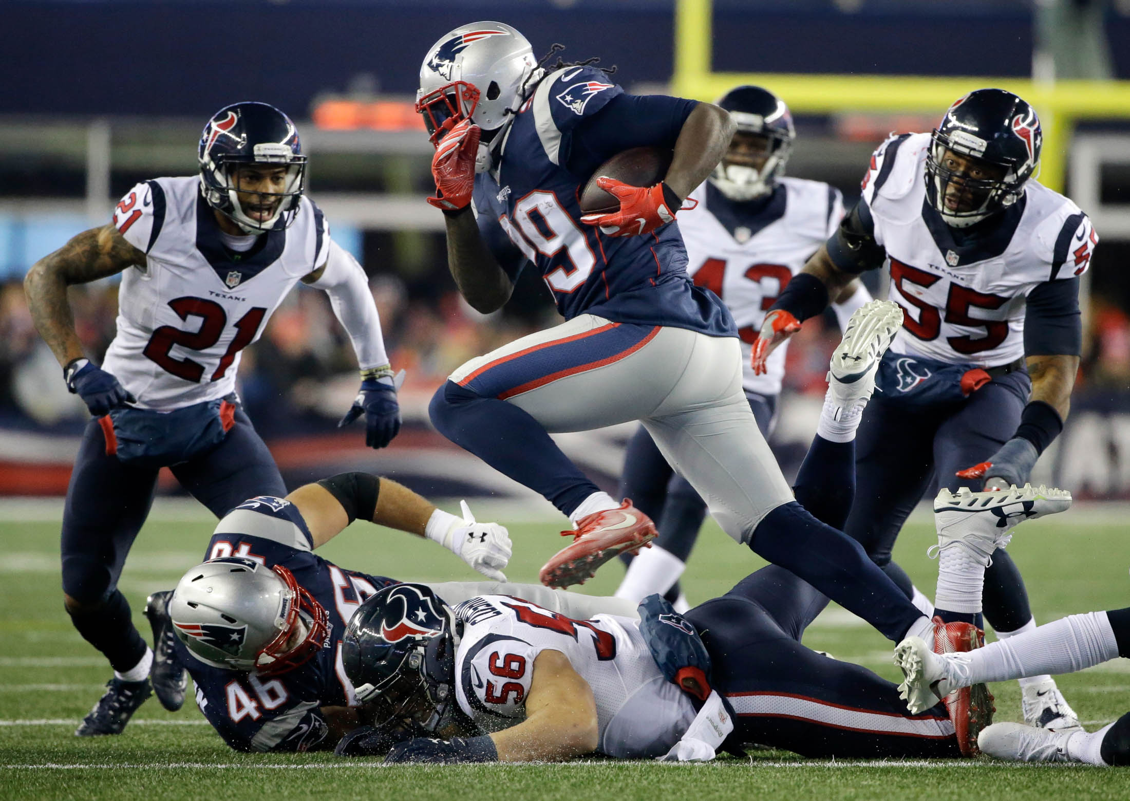 New England Patriots running back LeGarrette Blount (29) gains yardage as Houston Texans defenders A.J. Bouye (21) and Benardrick McKinney (55) pursue during the second half of an NFL divisional playoff football game, Saturday, Jan. 14, 2017, in Foxborough, Mass. (Elise Amendola/AP)