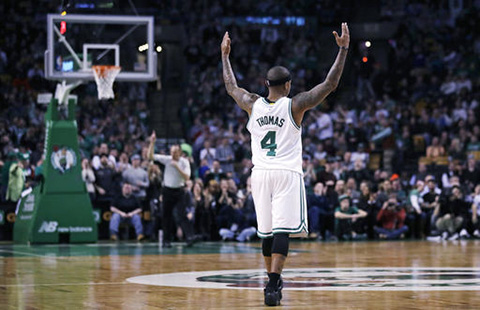 Boston Celtics guard Isaiah Thomas (4) raises his arms as he celebrates after hitting a 3-pointer against the Charlotte Hornets during the second half of an NBA basketball game in Boston, Monday, Jan. 16, 2017. Thomas had 35 points as the Celtics defeated the Hornets 108-98. (Charles Krupa/AP)