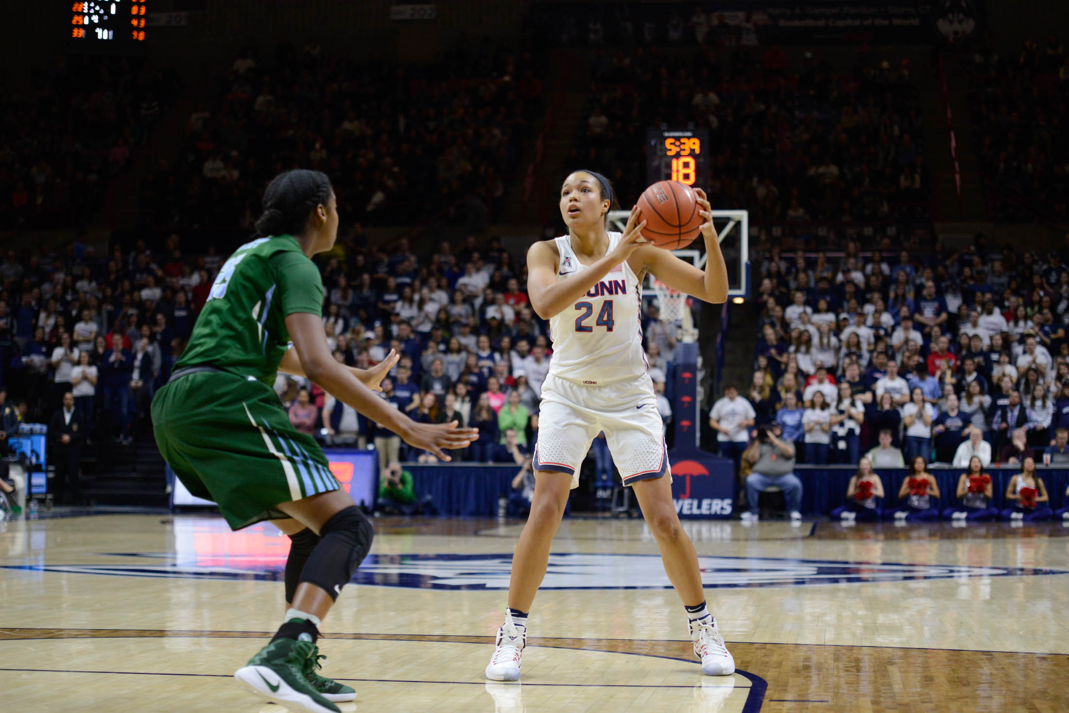 Sophomore forward Napheesa Collier (24) looks to pass in the Huskies' game against Tulane on Saturday, Jan. 22nd at Gampel Pavilion. (Jason Jiang/The Daily Campus)