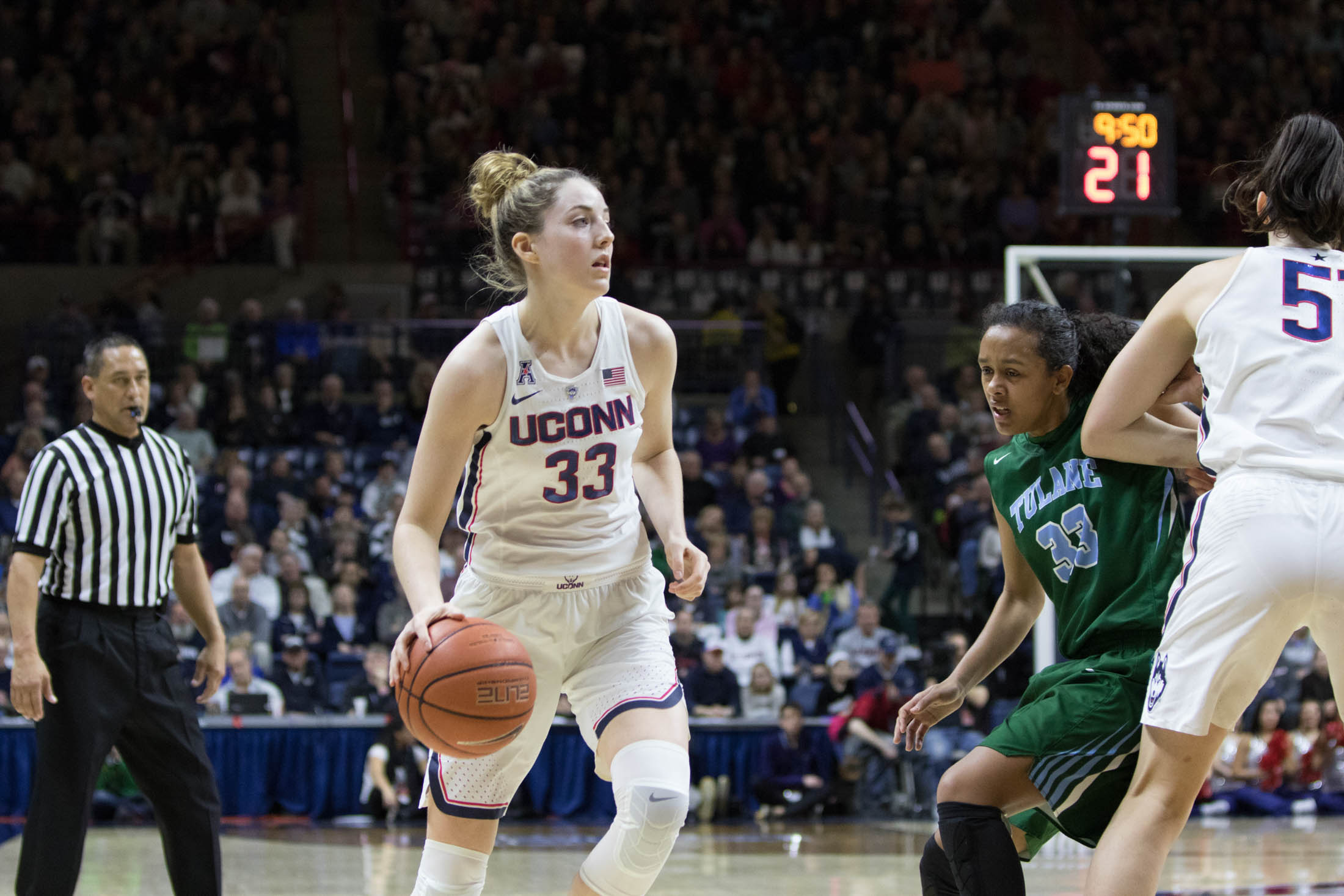 Sophomore Katie Lou Samuelson looks for a teammate during the Huskies 103-37 victory over USF on Tuesday, Jan. 10, 2016. (Jackson Haigis/The Daily Campus)