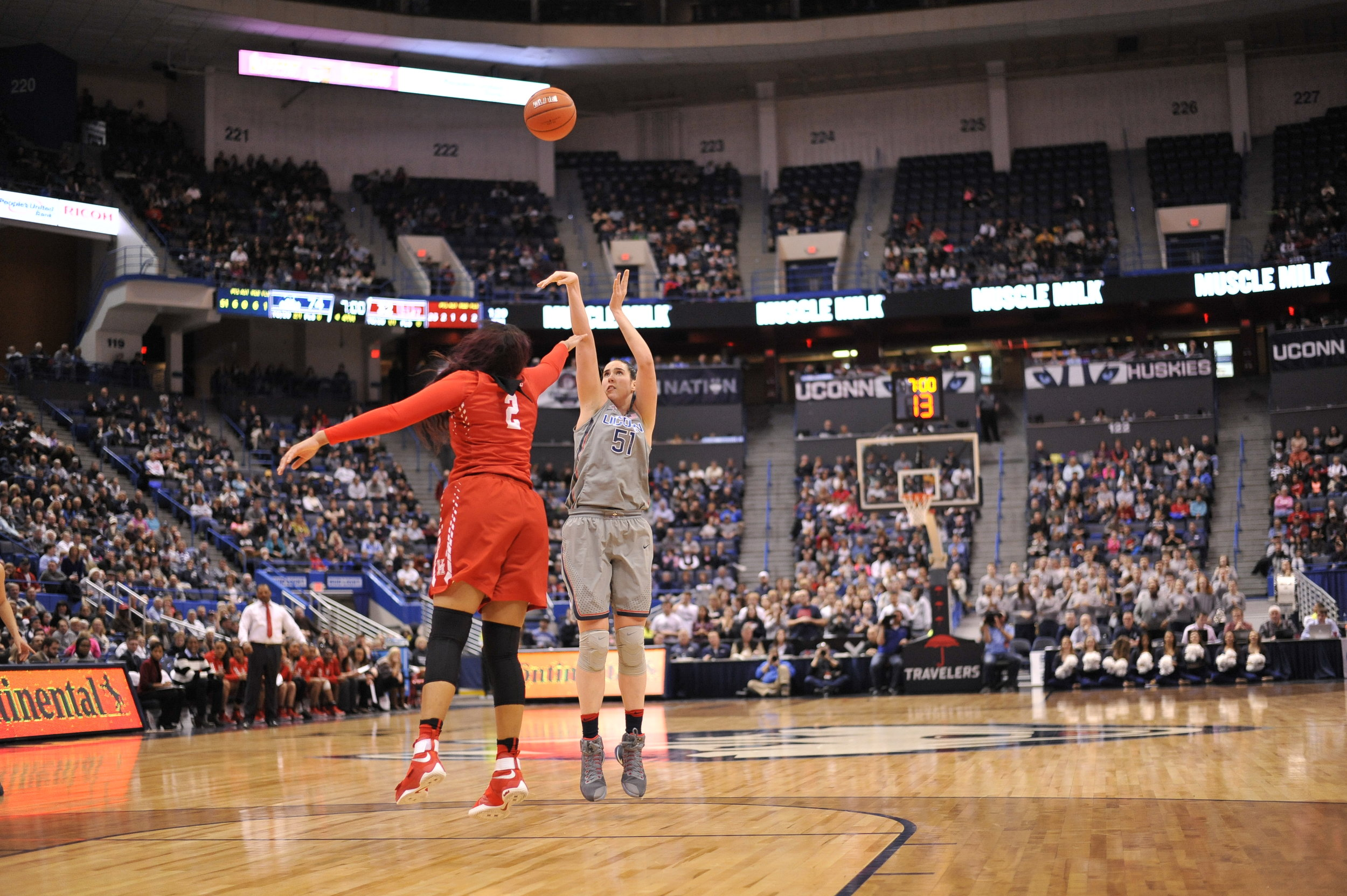 Natalie Butler, who scored 10 points for the Huskies, takes a jump shot. (Jason Jiang/The Daily Campus)